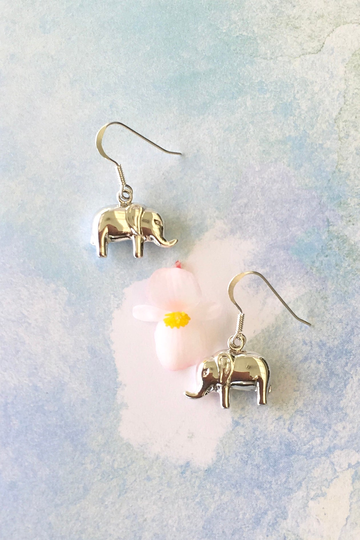 sweet little earrings with a tiny shiny elephant are made in fine solid 925 silver