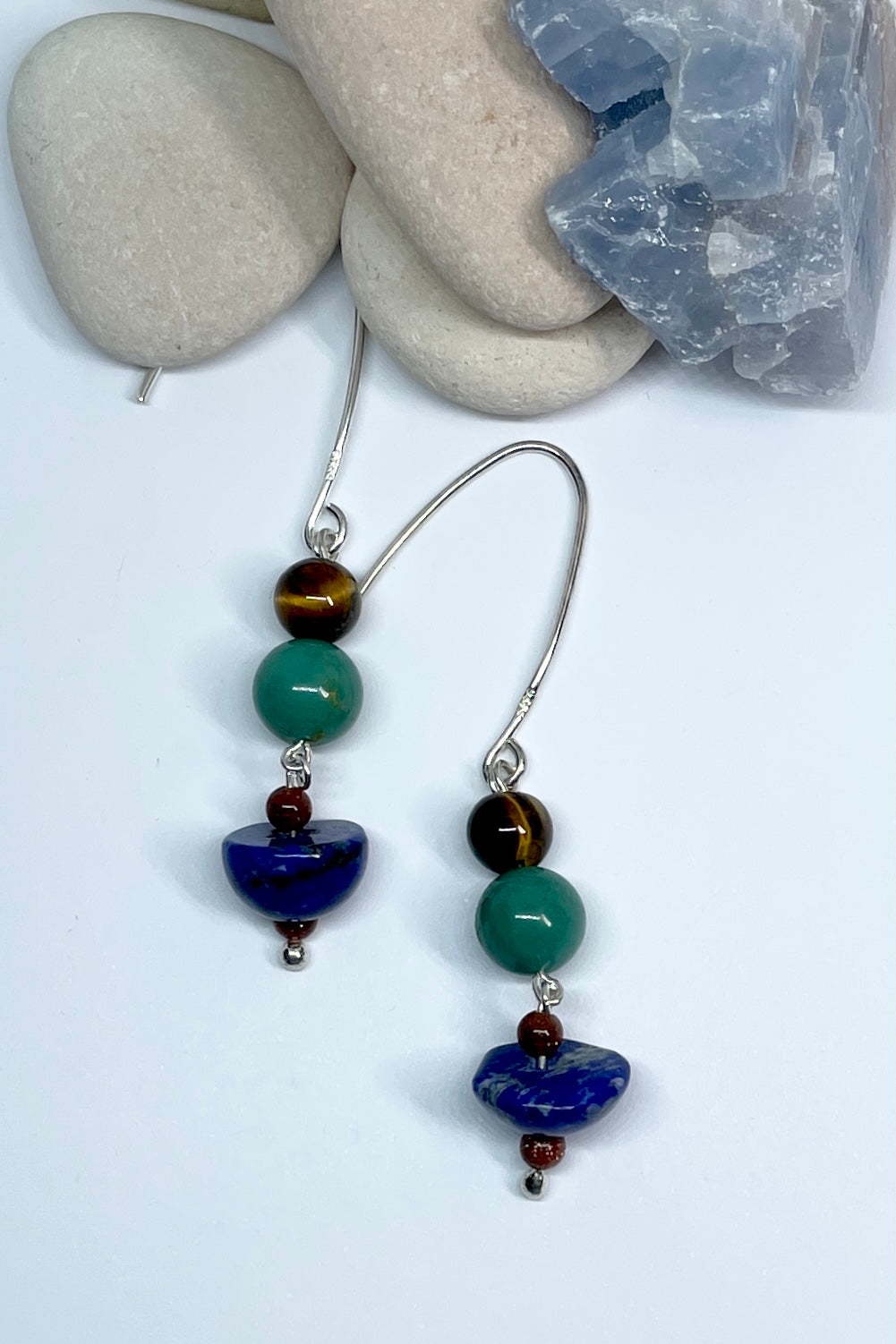 earrings with a deep blue Lapis Lazuli and a dark turquoise Chrysacola bead.