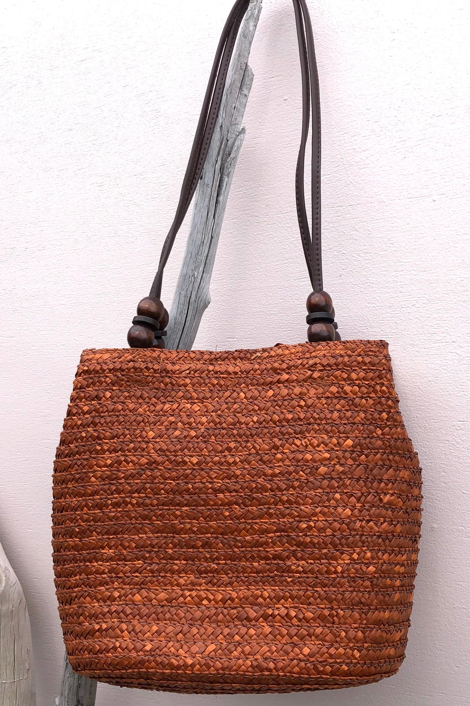 Bag Ava Palma Straw in Tan colour is a boho inspired beach style woven straw bag in a tan rust colour