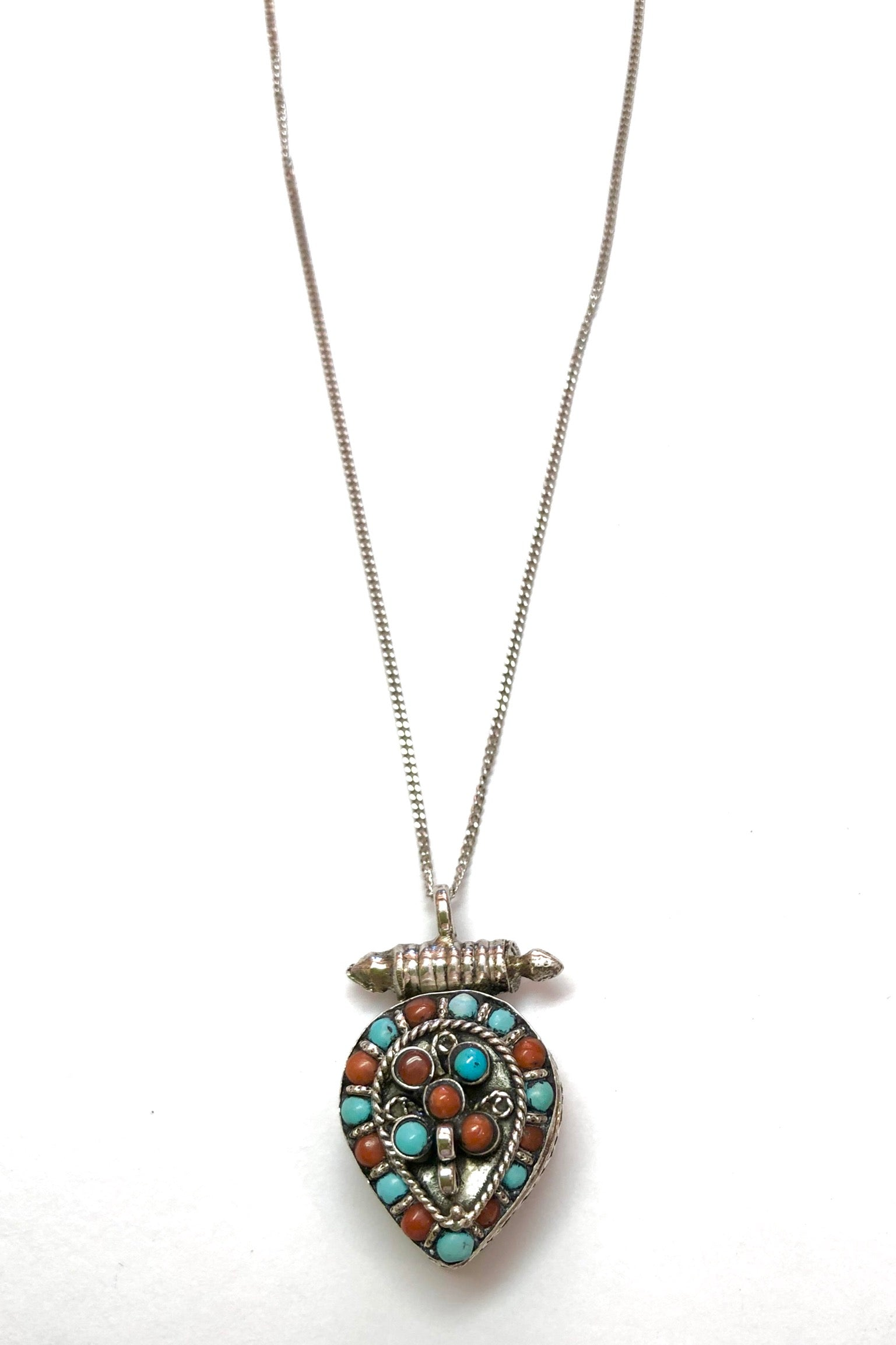 Echo Box Pendant Silver with Turquoise and Coral is a 925 silver box pendant featuring natural turquoise and coral applied.