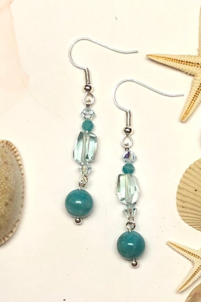 The Serendipity Earrings are handmade earrings in Amazonite and Fluorite gemstones featuring 5.2cm long total and some stones are village cut.