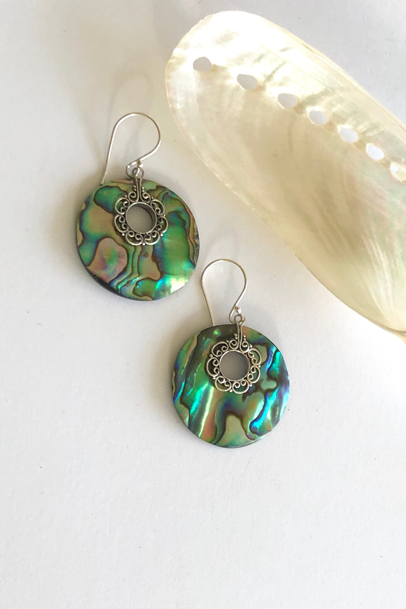 Earrings Cay Paua Circle are gorgeous iridescent discs of the paua stone with silver detailing.