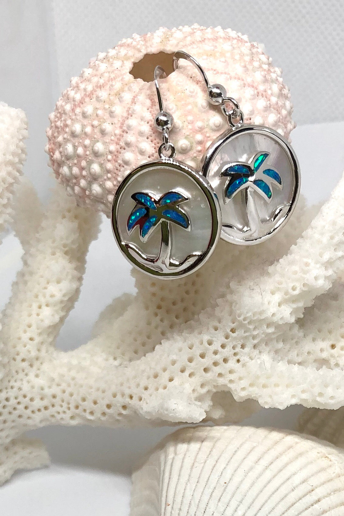 Earrings With Mother of pearl silver and pretty blue opalescent chips in the palm fronds.
