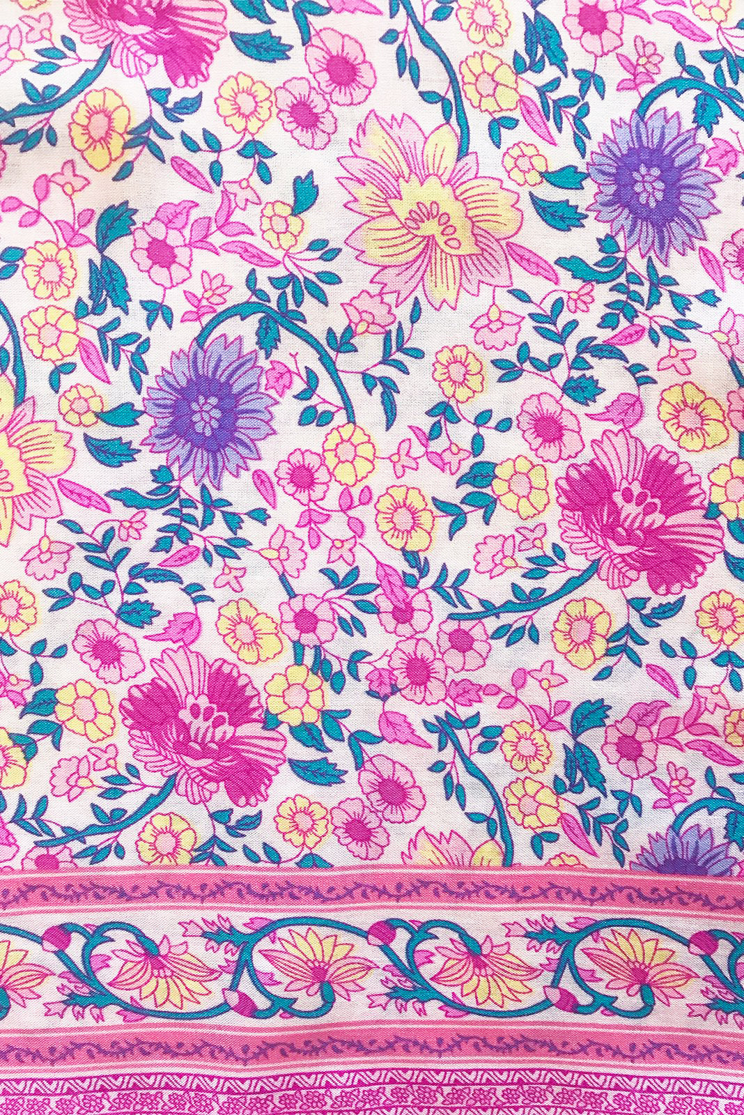 Fabric swatch, 100% woven viscose, soft pink base with medium fuchsia, soft pink, purple, lavender, yellow and teal floral print.