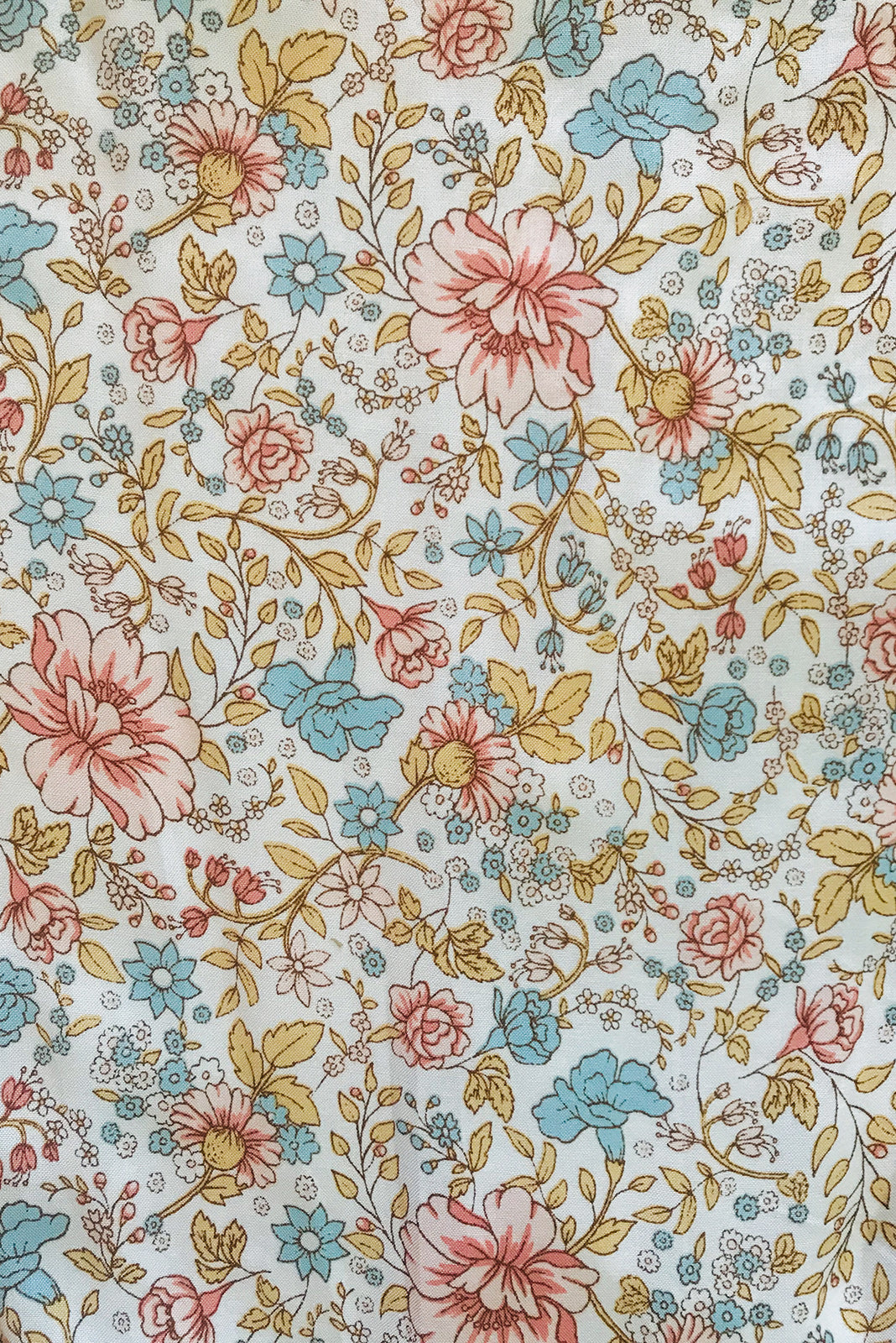Fabric swatch, 100% woven rayon, off-white base with medium peach, gold and light blue floral print.