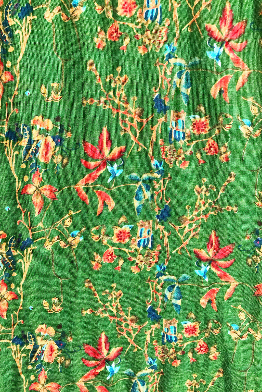 Fabric swatch, 100% woven cotton, bright green base with medium orange, gold, navy and blue floral print.