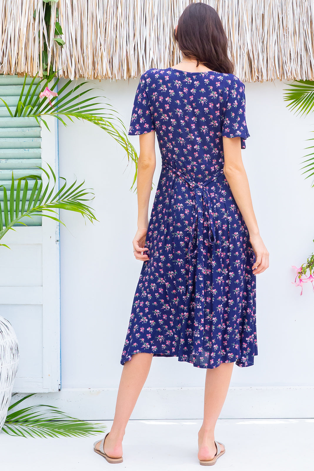 Faithful Ditzy Navy Midi dress features a button front, soft petal sleeve and deep side pockets it is made in a crinkled woven rayon and comes in a bright navy ditzy floral print