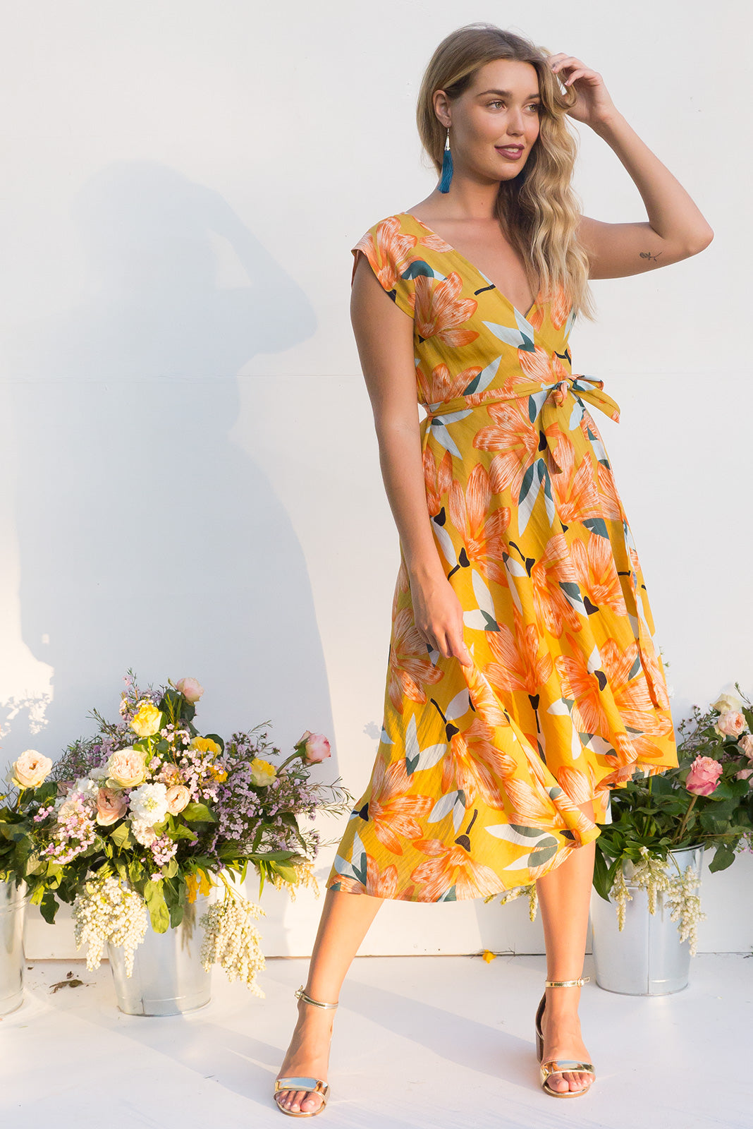 Fanciful Golden Lilly Wrap Dress featuring a fitted cross over bust and flirty skirt in a large vintage floral print print
