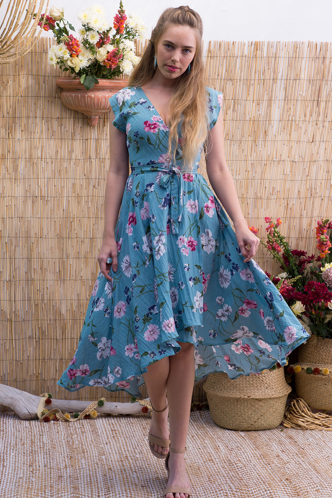 Florence Aero Blue Wrap Dress featuring a fitted cross over bust and flirty skirt with side pocket  in a sea foam green blue floral print on a ripple textured polyester blend fabric
