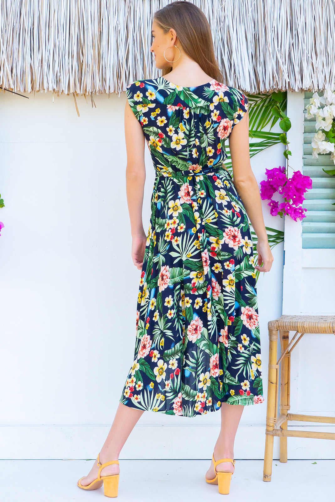 Florence Forest Noir Wrap Dress Square featuring a fitted cross over bust and flirty skirt with side pocket in a  bold tropical inspired floral print with a deep inky navy base print on a soft smooth finish rayon fabric