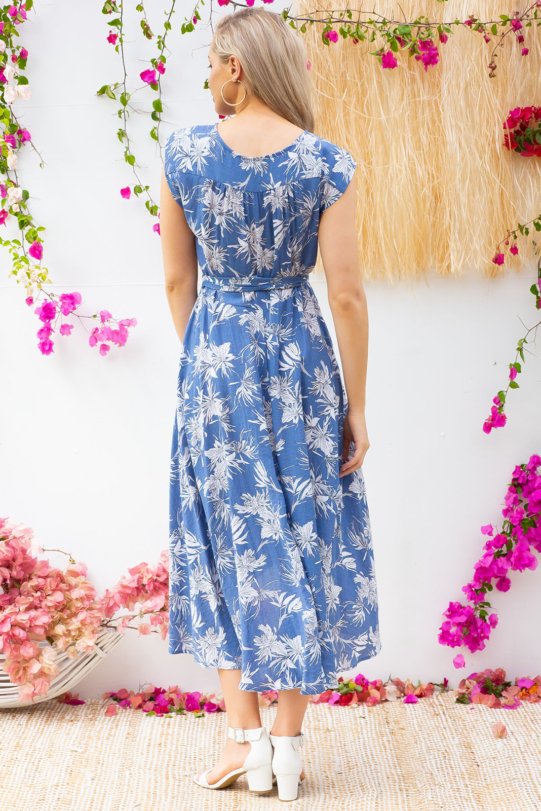 Florence Blue Island Wrap Dress featuring a fitted cross over bust and flirty skirt with side pocket  in a  blue floral print on a ripple textured polyester blend fabric