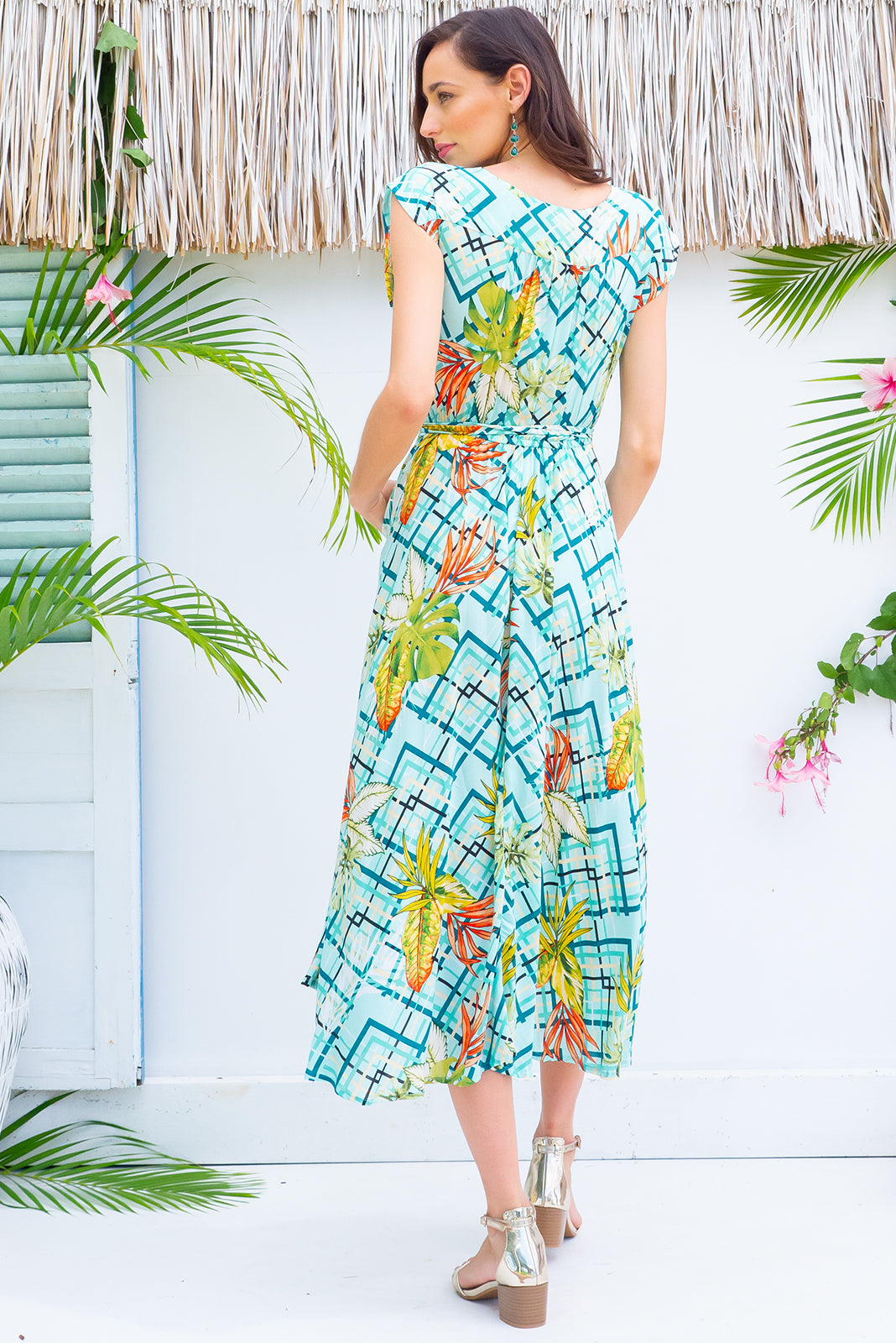 Florence Mint Leaf Wrap Dress featuring a fitted cross over bust and flirty skirt with side pocket  in a vintage inspired graphic mint based print on a soft smooth finish rayon fabric