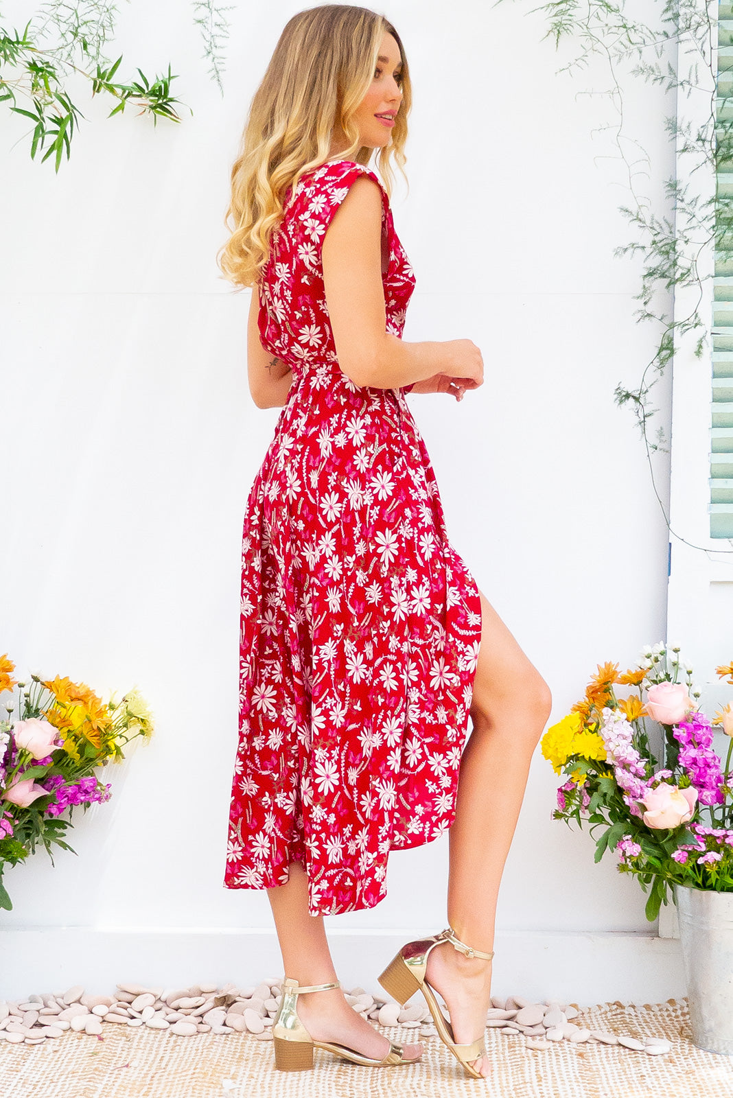 Florence Red Daisy Wrap Dress featuring a fitted cross over bust and flirty skirt with side pocket  in a delicate tonal daisy floral on a true red base print on a soft smooth finish rayon fabric