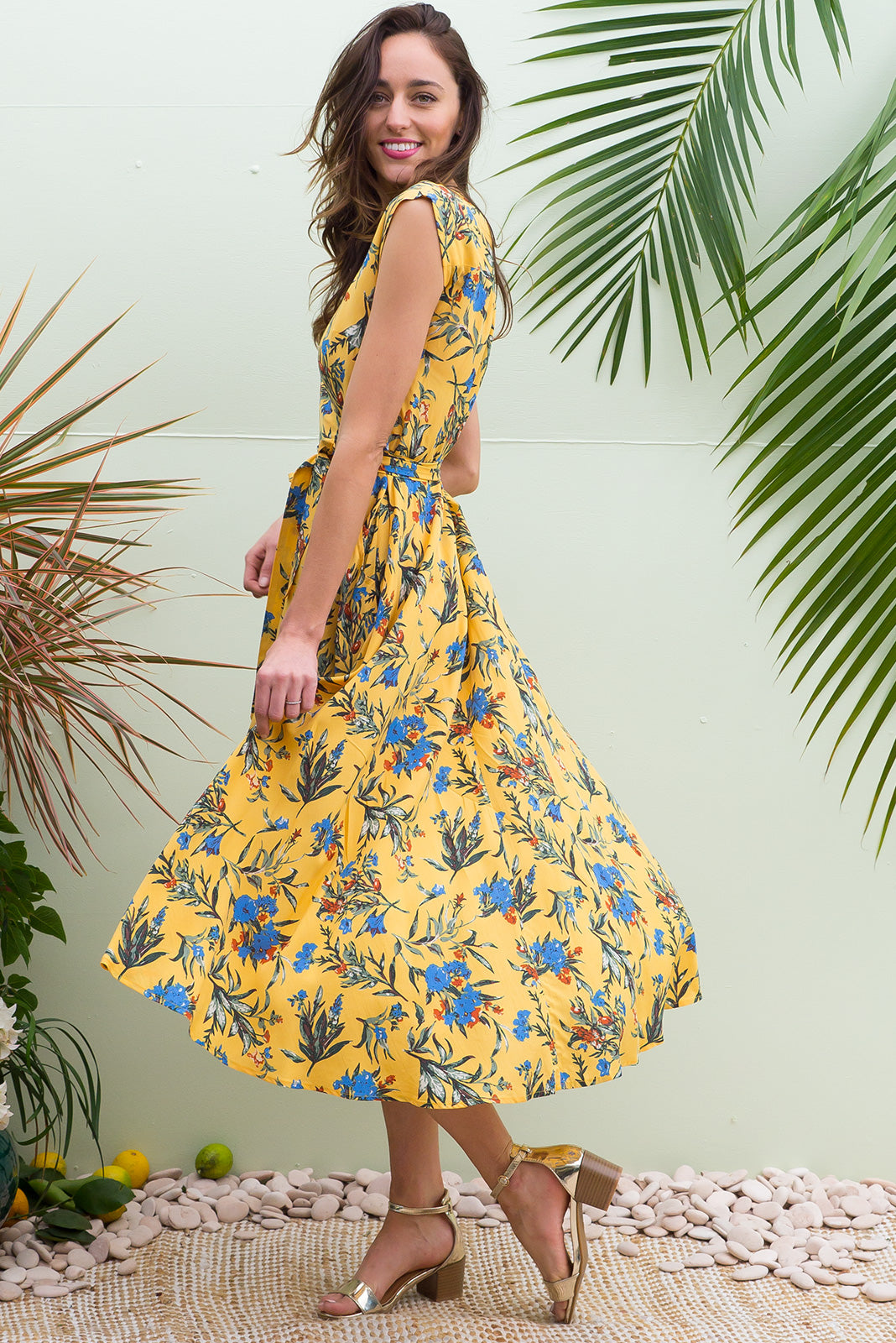 Florence Jasmine Gold  Wrap Dress featuring a fitted cross over bust and flirty skirt with side pocket  in a retro bohemian floral on a strong sunshine yellow print on a soft smooth finish rayon fabric