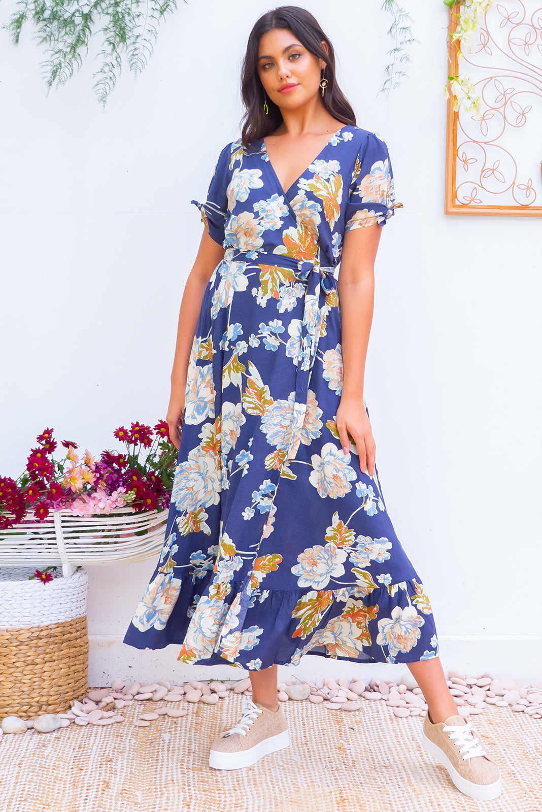 Francoise Blue Vintage Maxi Wrap dress with side split flutter sleeves, a wrap around adjustable waist, v neckline and frill hem in a soft dusky blue based watercolour floral print in autumn tones