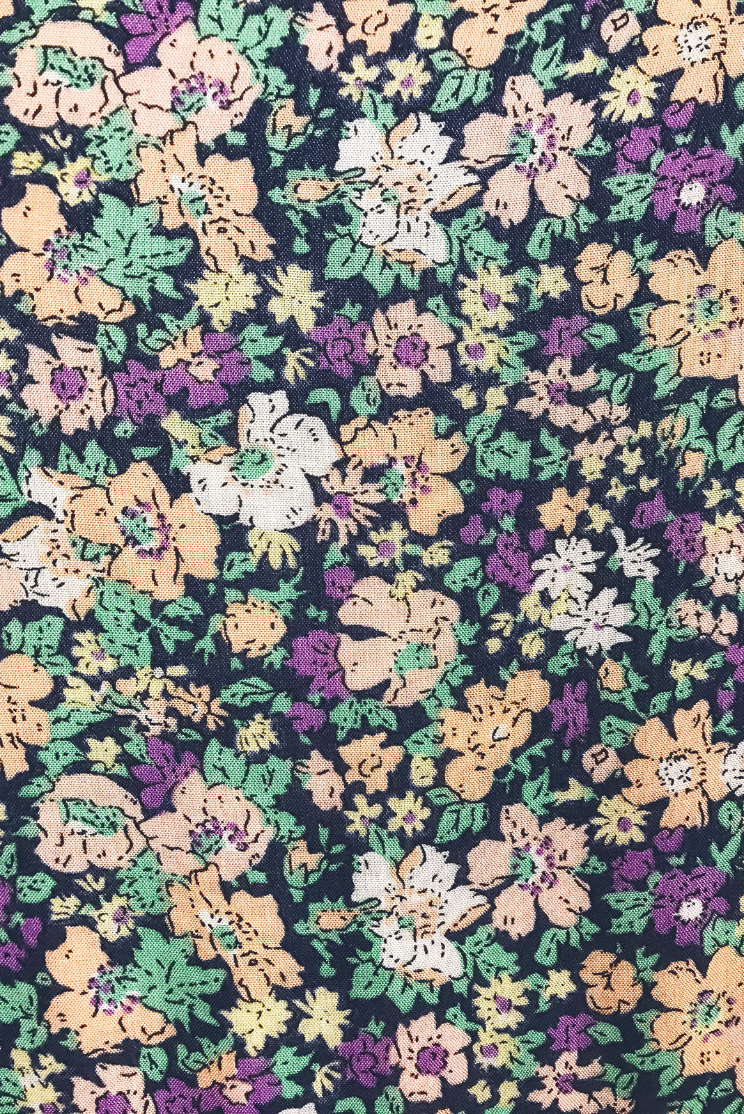 Fabric Swatch of  Georgie Country Mauve Dress featuring 100% rayon in navy base with pink, purple and white floral print.