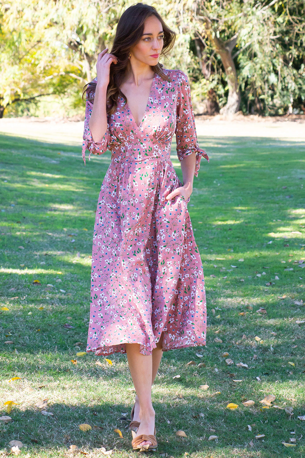 Henrietta Antique Rose Dress is a classic & feminine style featuring elasticised back waist, 3/4 sleeves with cuff ties, side pockets, dusky petal pink base with ditzy floral print of white and blue in woven 100% rayon.
