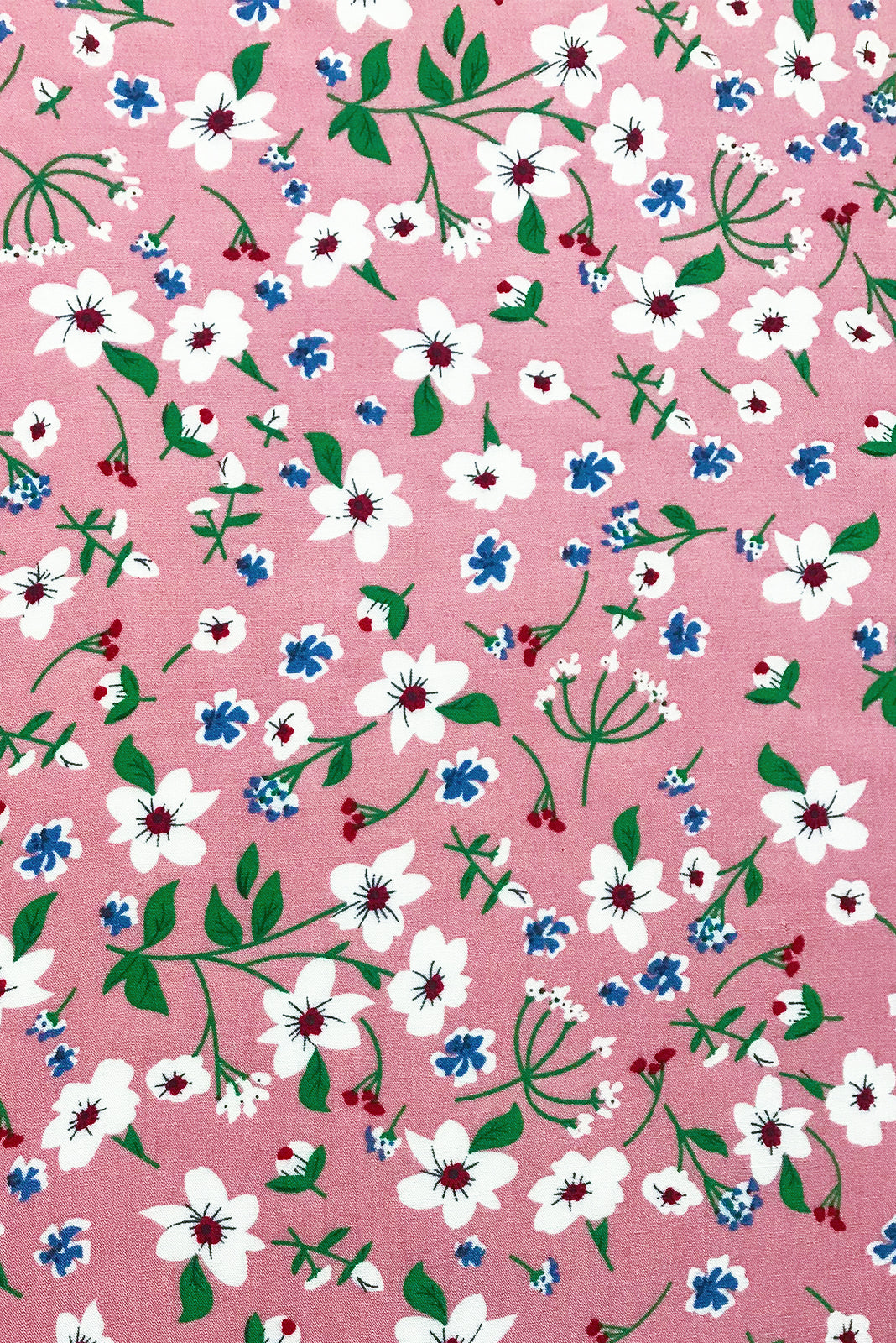 Fabric Swatch of Henrietta Antique Rose Dress features woven 100% rayon in Gorgeous dusky petal pink base with ditzy floral print of white and blue.