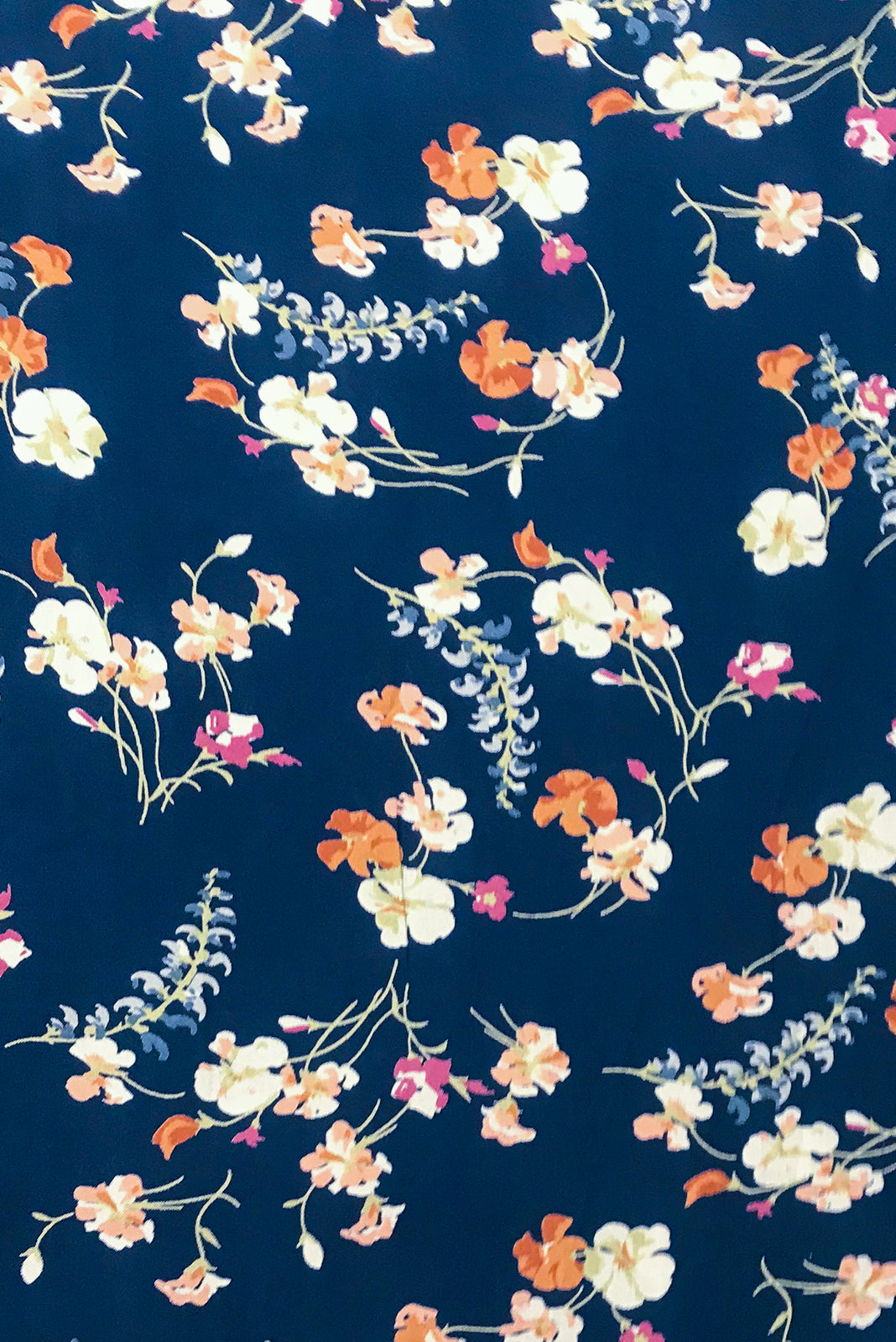 Fabric Swatch of Henrietta Wildflowers Navy Dress is made of woven 100% rayon in Navy base with a romantic pink, red and blue floral print.