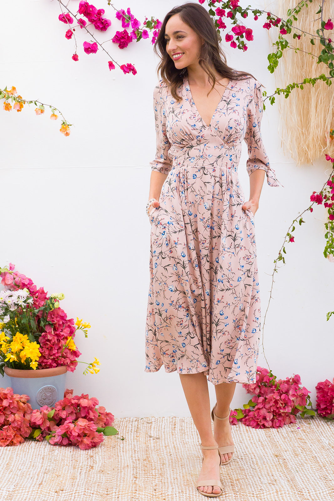 Henrietta Blush Pink Midi dress features a vintage inspired fitted basque waist and elasticated waist with a midi sleeve and deep v neck the fabric is a soft woven rayon in a soft dusky blush rose pink and floral print