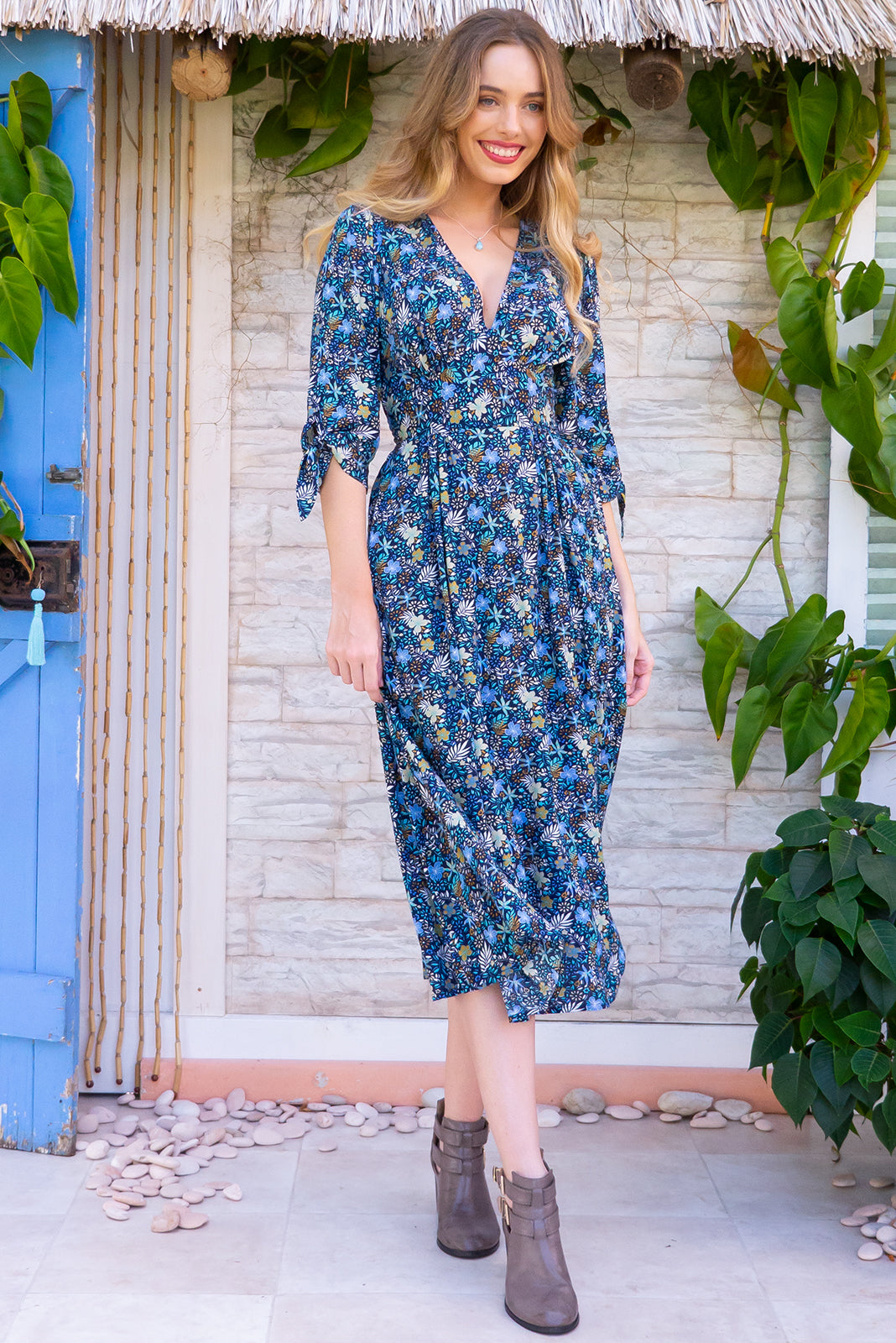 Henrietta Navy Forest Floor Midi dress features a vintage inspired fitted basque waist and elasticated waist with a midi sleeve and deep v neck the fabric is a soft woven rayon in a soft romantic bright bohemian ditzy floral print