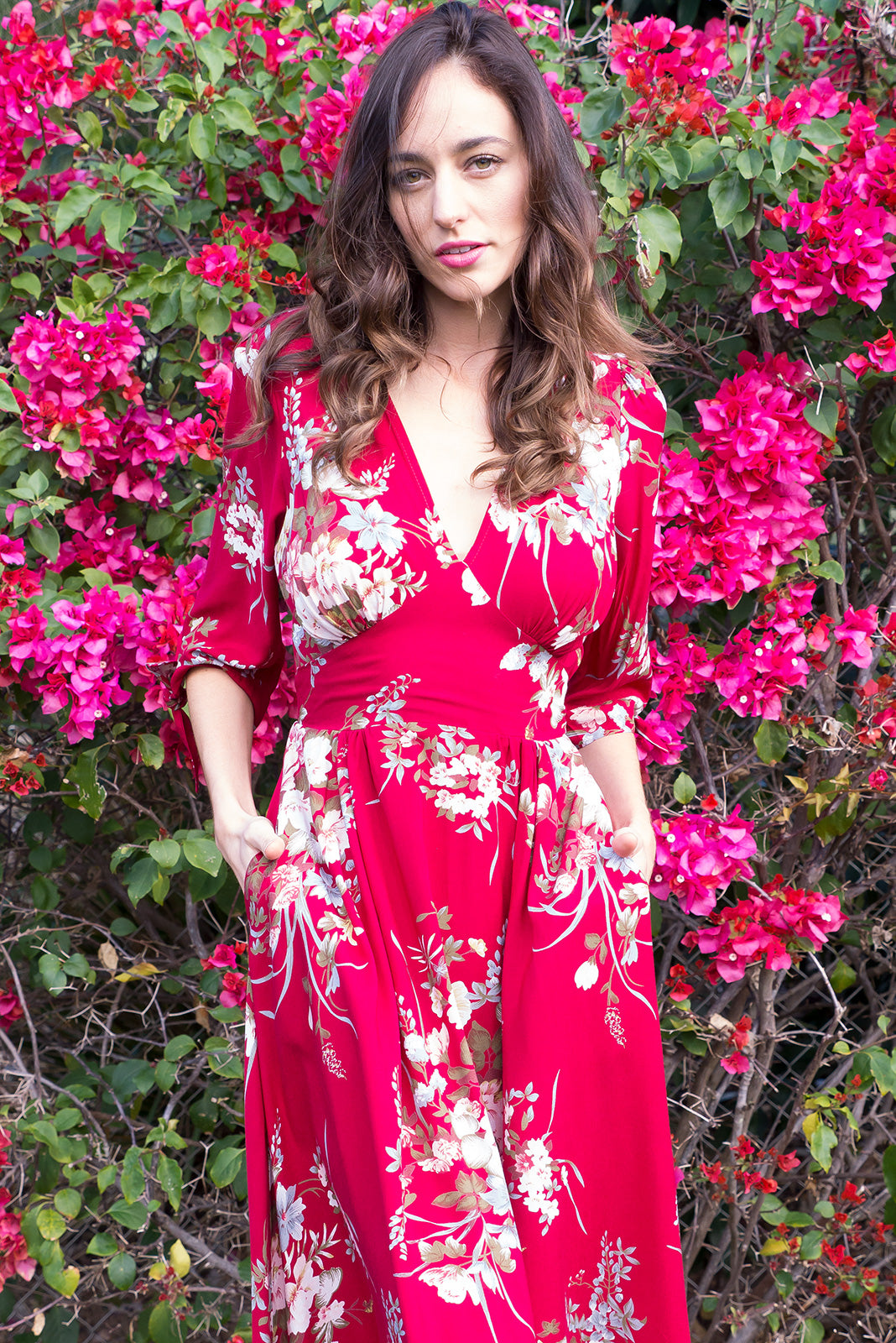 Henrietta Red Bouquet Midi dress features a vintage inspired fitted basque waist and elasticated waist with a midi sleeve and deep v neck the fabric is a soft woven rayon in a bright red floral bouquet print