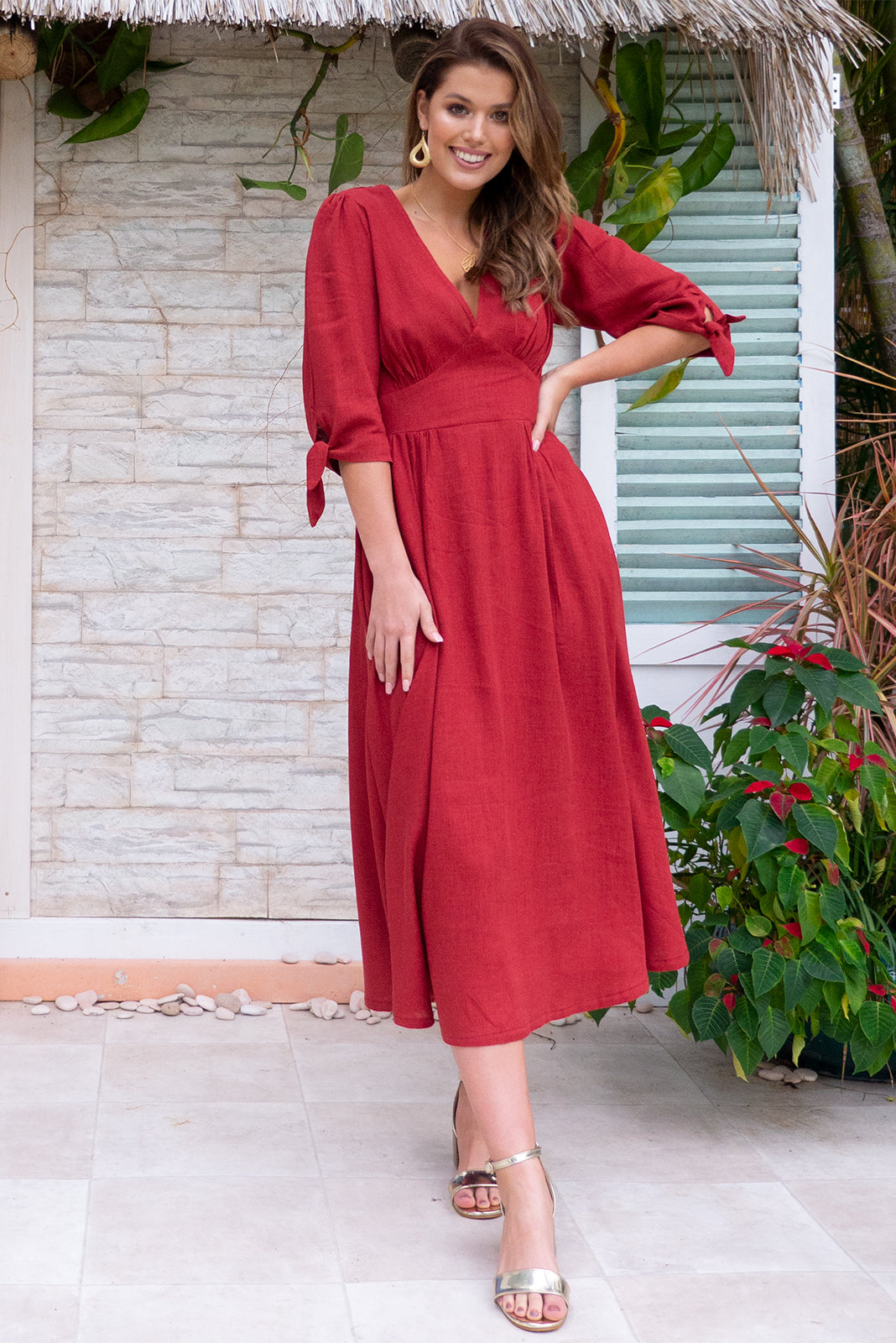 Henrietta Redcurrant Midi dress features a vintage inspired fitted basque waist and elasticated waist with a midi sleeve and deep v neck the fabric is a soft woven rayon linen mix in a bright romantic red