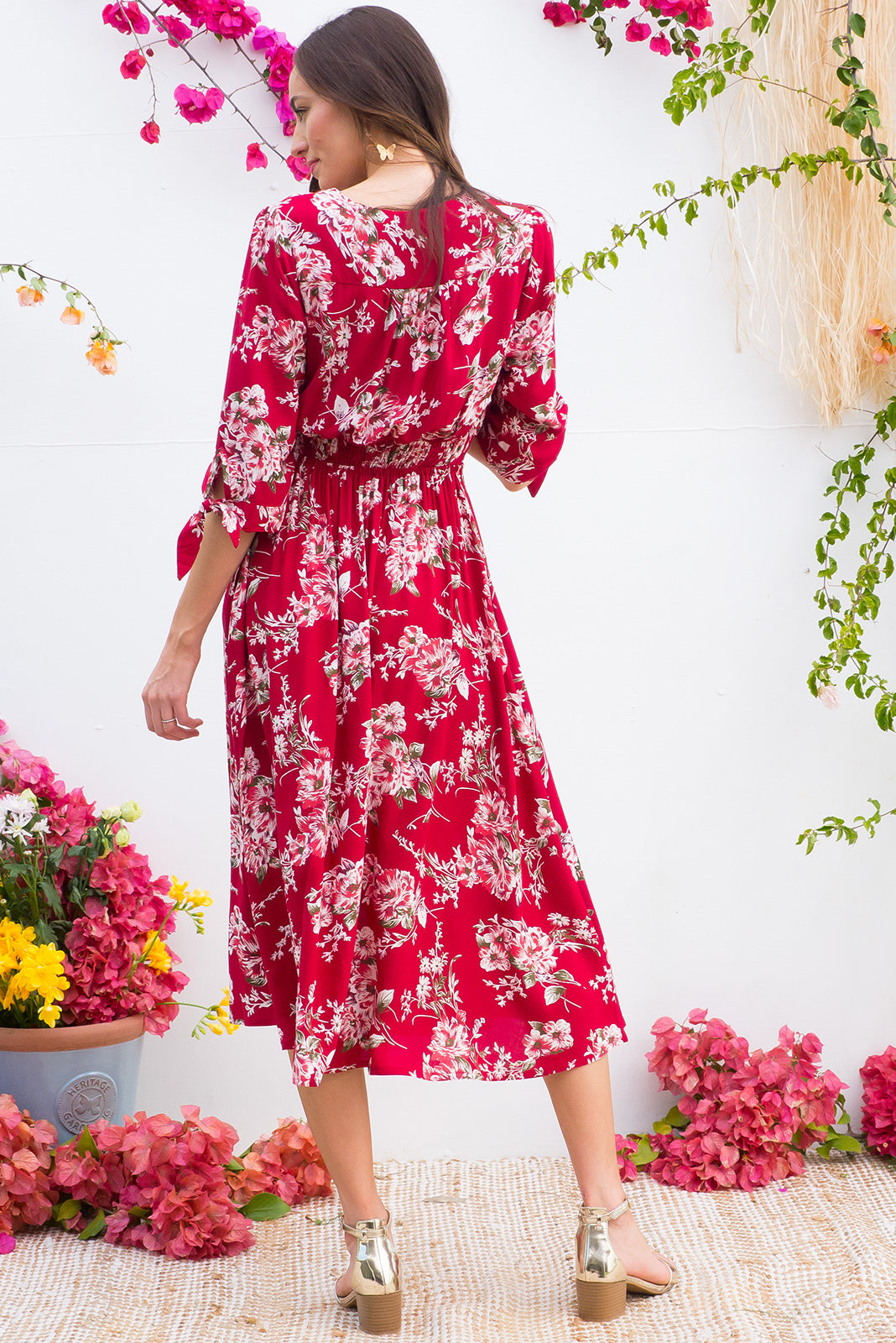 Henrietta Red Flowers Midi dress features a vintage inspired fitted basque waist and elasticated waist with a midi sleeve and deep v neck the fabric is a soft woven rayon in a bright red floral print