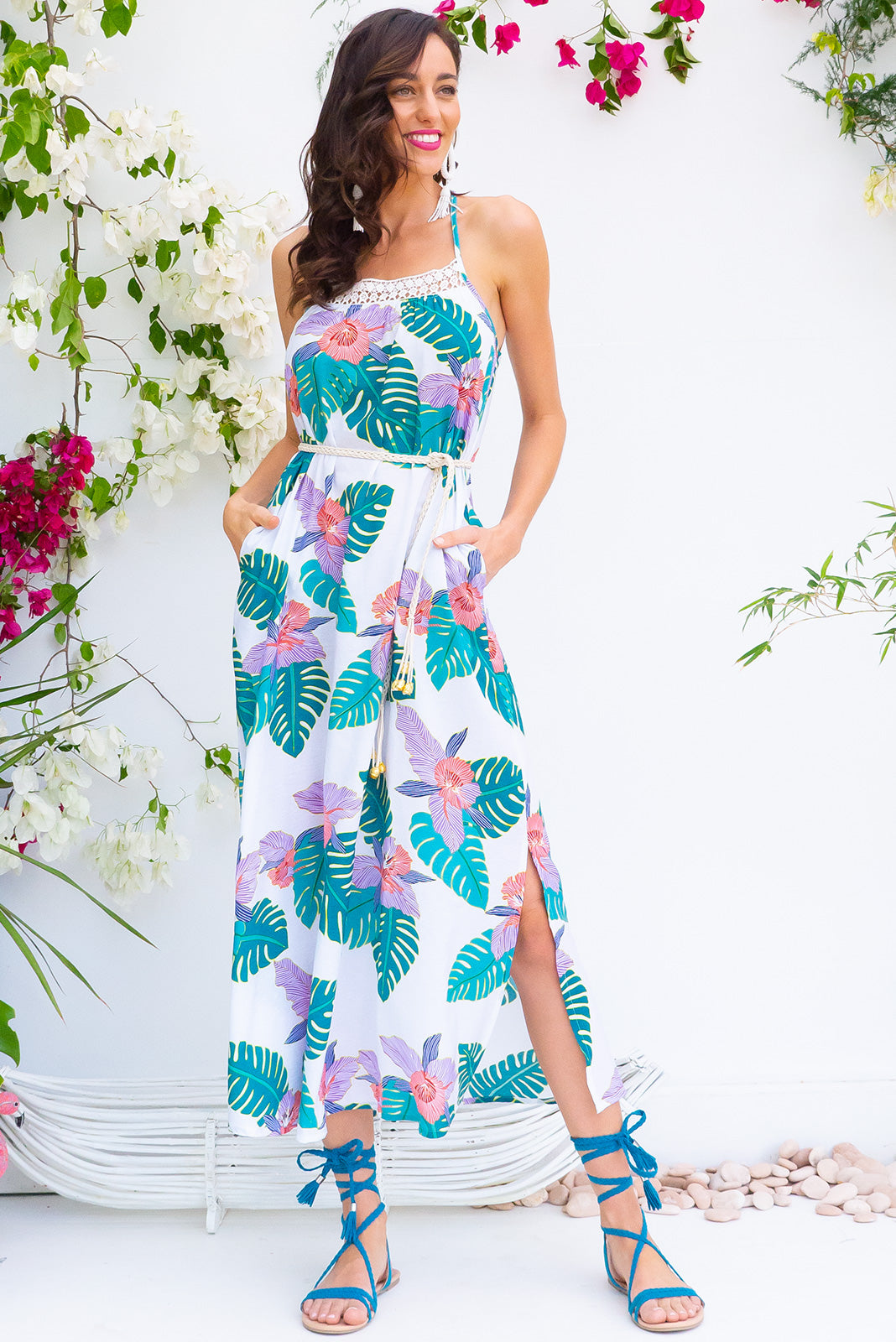 Hibiscus Maxi Beach Dress in a bright tropical leaf print on a rayon nylon blend woven fabric comes with adjustable straps and a plaited belt