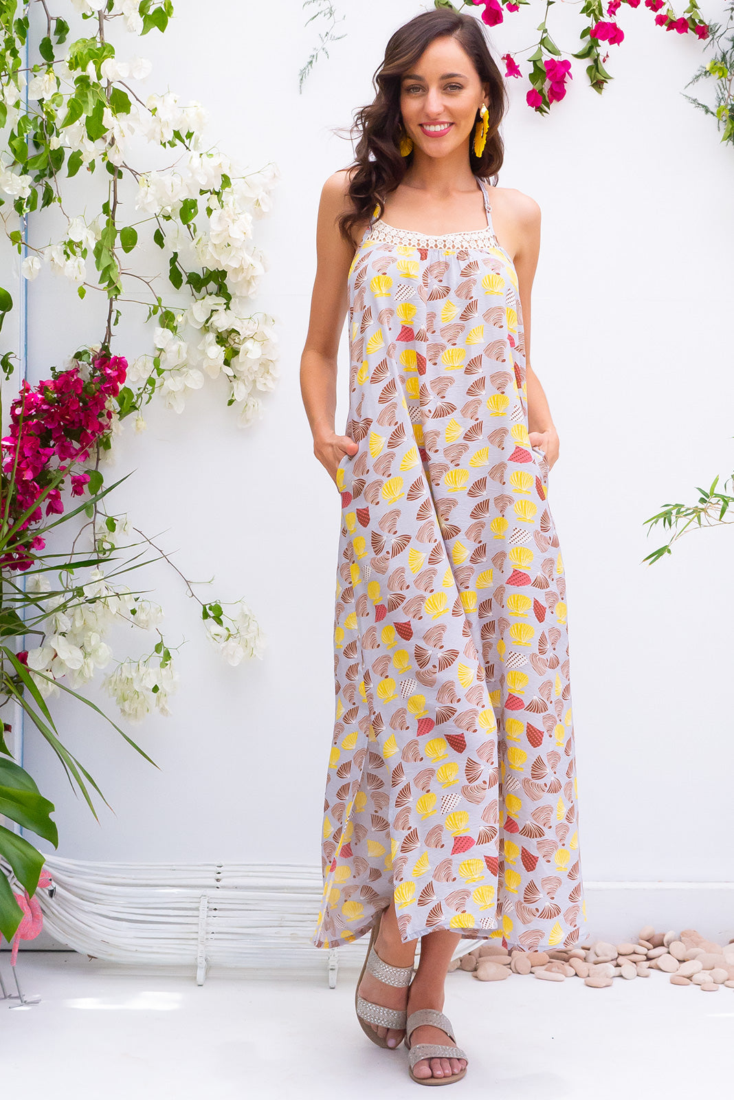 Hibiscus Shelly Beach Maxi Beach Dress in a soft silver and gold shell print print on a rayon nylon blend woven fabric comes with adjustable straps and a plaited belt