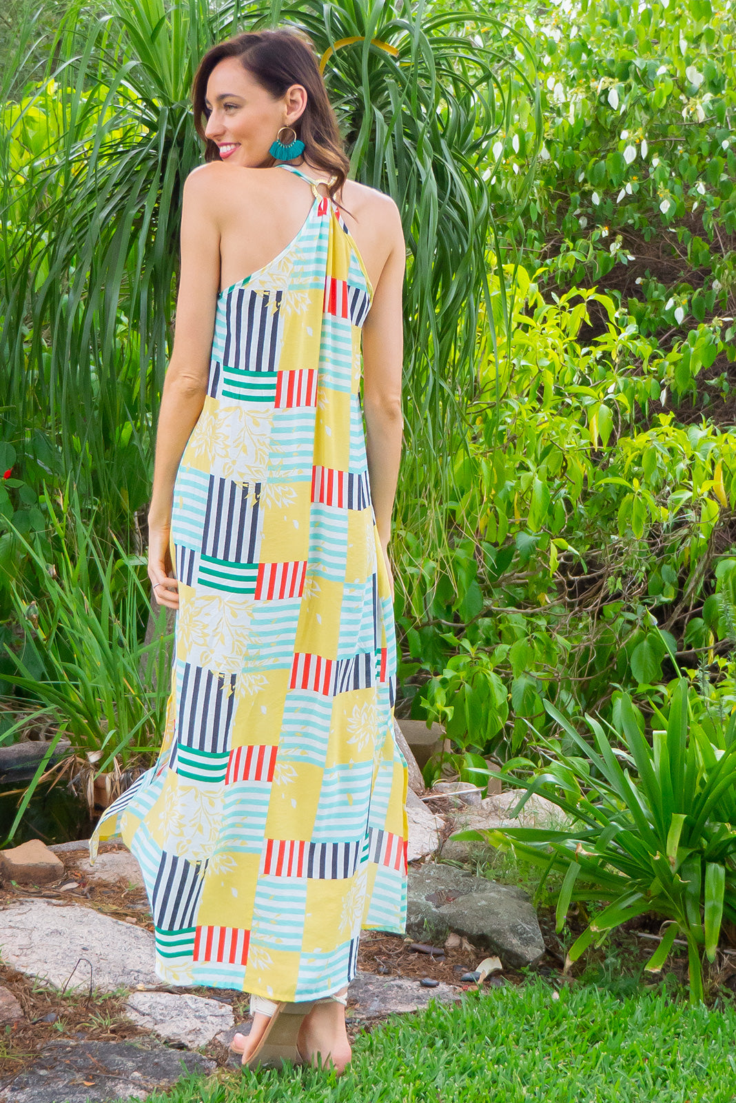Hibiscus Square Dance Maxi Beach Dress in a chic geometric patchwork prin on a rayon nylon blend woven fabric comes with adjustable straps and a plaited belt