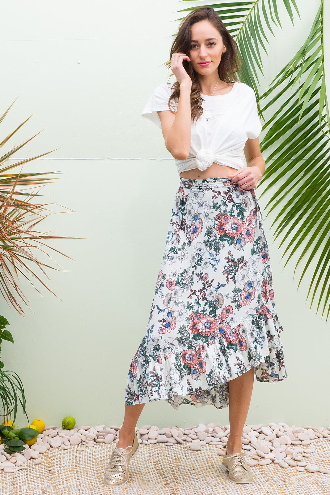 Highlight Chelsea Floral Wrap Skirt with a deep frill in a soft botanical print on a crinkle texture woven rayon.
