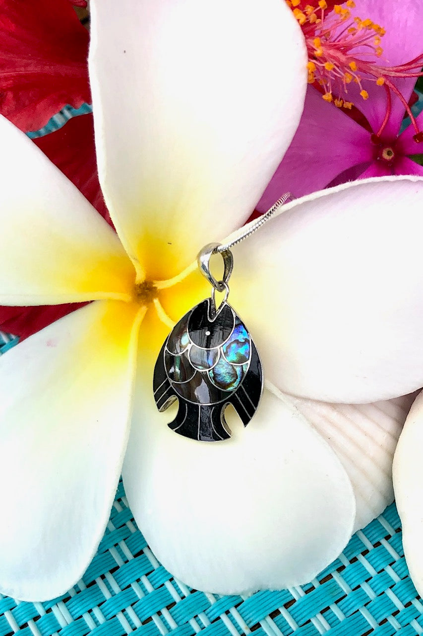 A beautiful handmade necklace in the shape of a fish,with a mysterious Paua shell setting