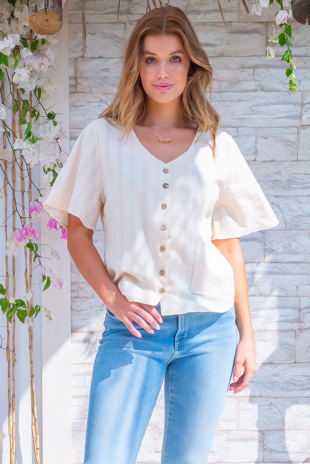 Indigo Ecru Cream Top, 100% cotton, bohemian summer style, scoop neckline, functional button front, short sleeves, single front pocket, warm cream base with subtle textured stripe pattern.