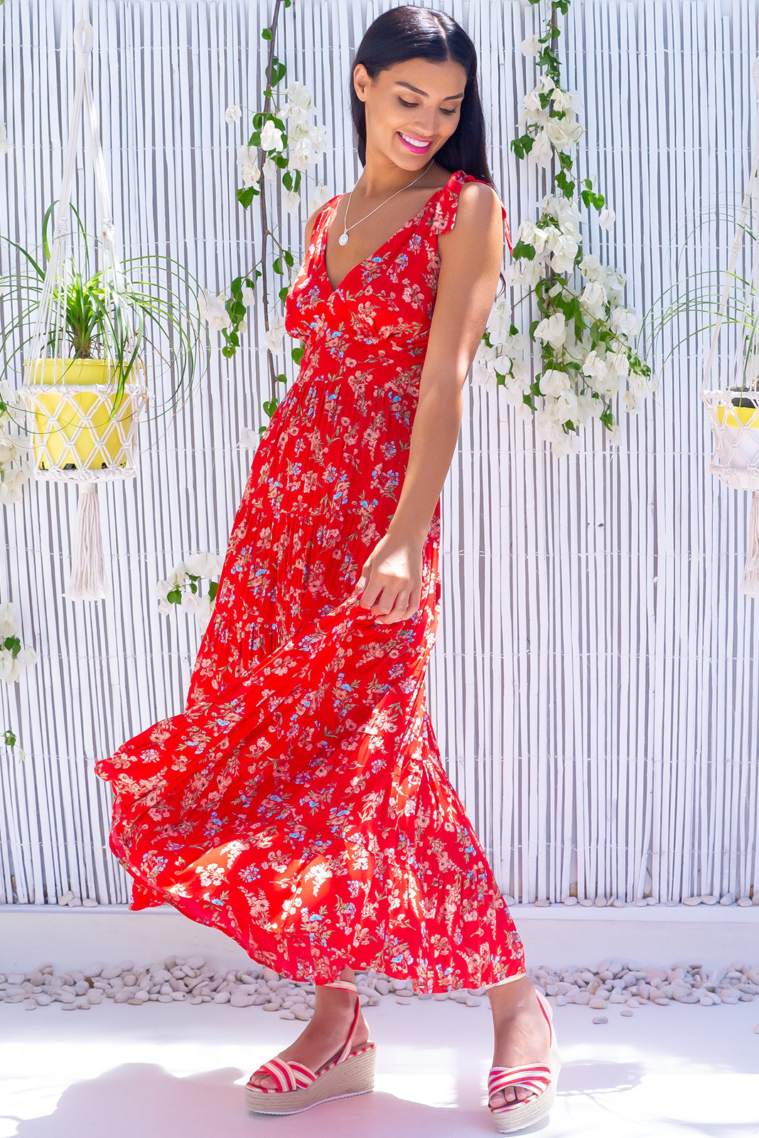 The Isla Lava Red Maxi Dress is perfect for cocktails at the Tiki Bar, this beauty features adjustable tie up shoulders, side pockets and 100% viscose in bright red base with pale rust floral print.
