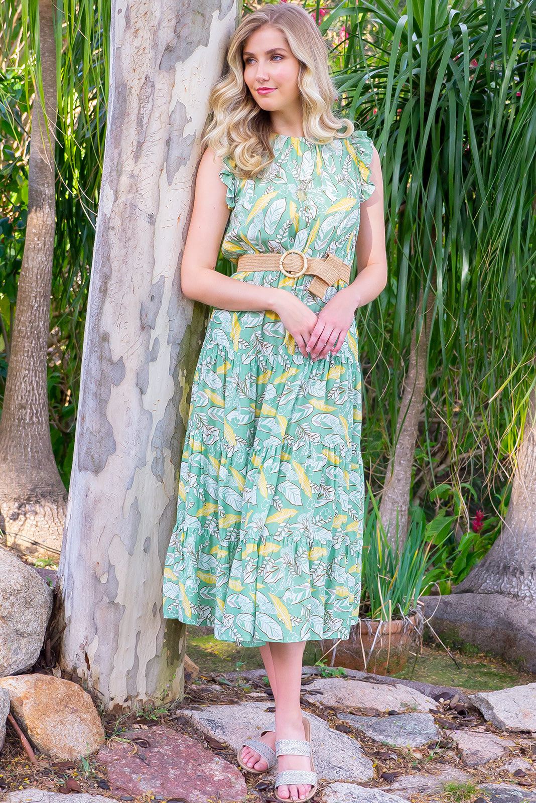 Jasmine Green Fern Maxi Dress in green and gold 100% rayon fabric. Tiered skirt, complimentary belt, frill short sleeves, high neck and side pockets.