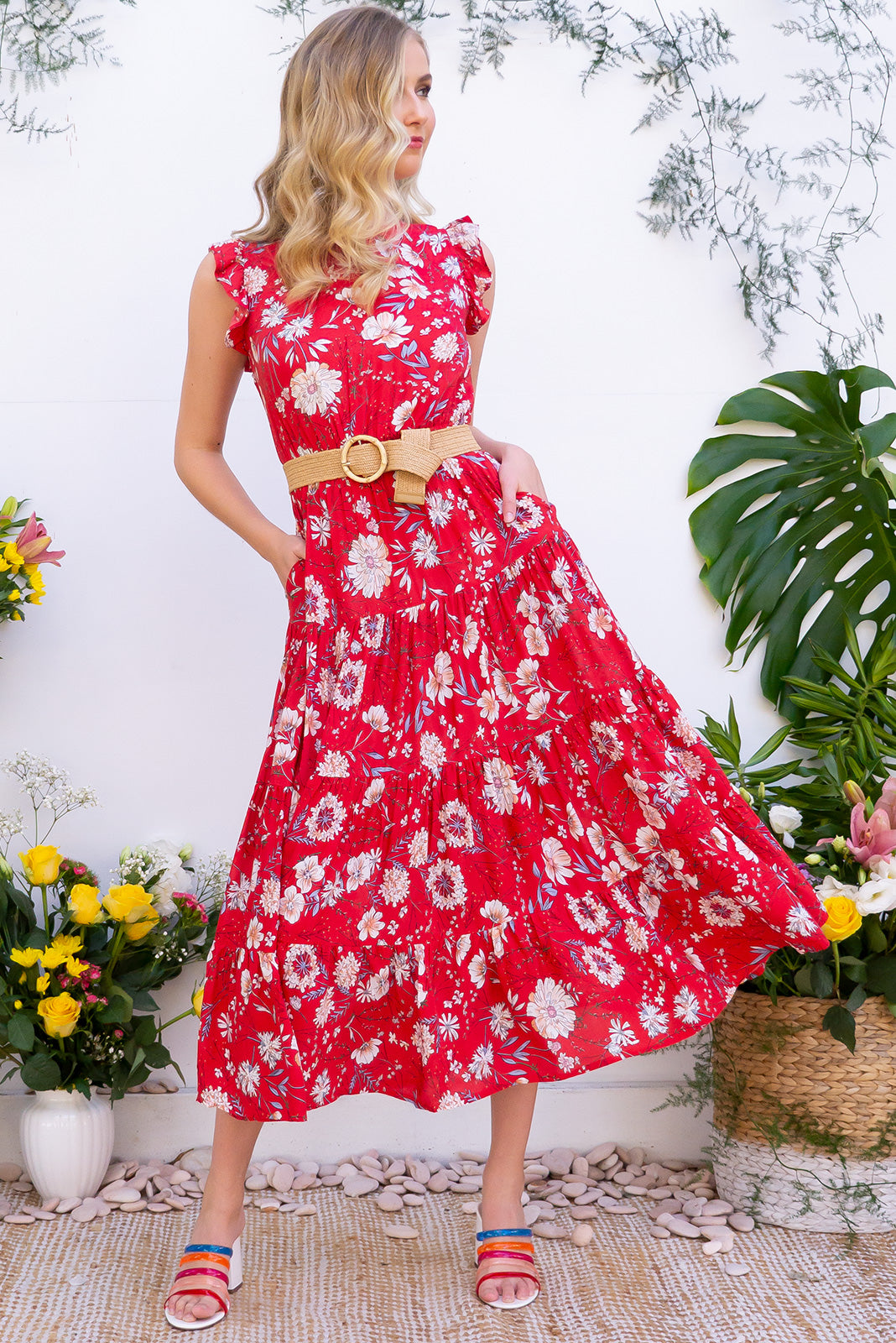 Jasmine Red Romance Maxi Dress features a vintage inspired high neck and a feminine short butterfly sleeve. Made from rayon red fabric in a classic floral print. Includes rattan belt, side pockets and tiered skirt.