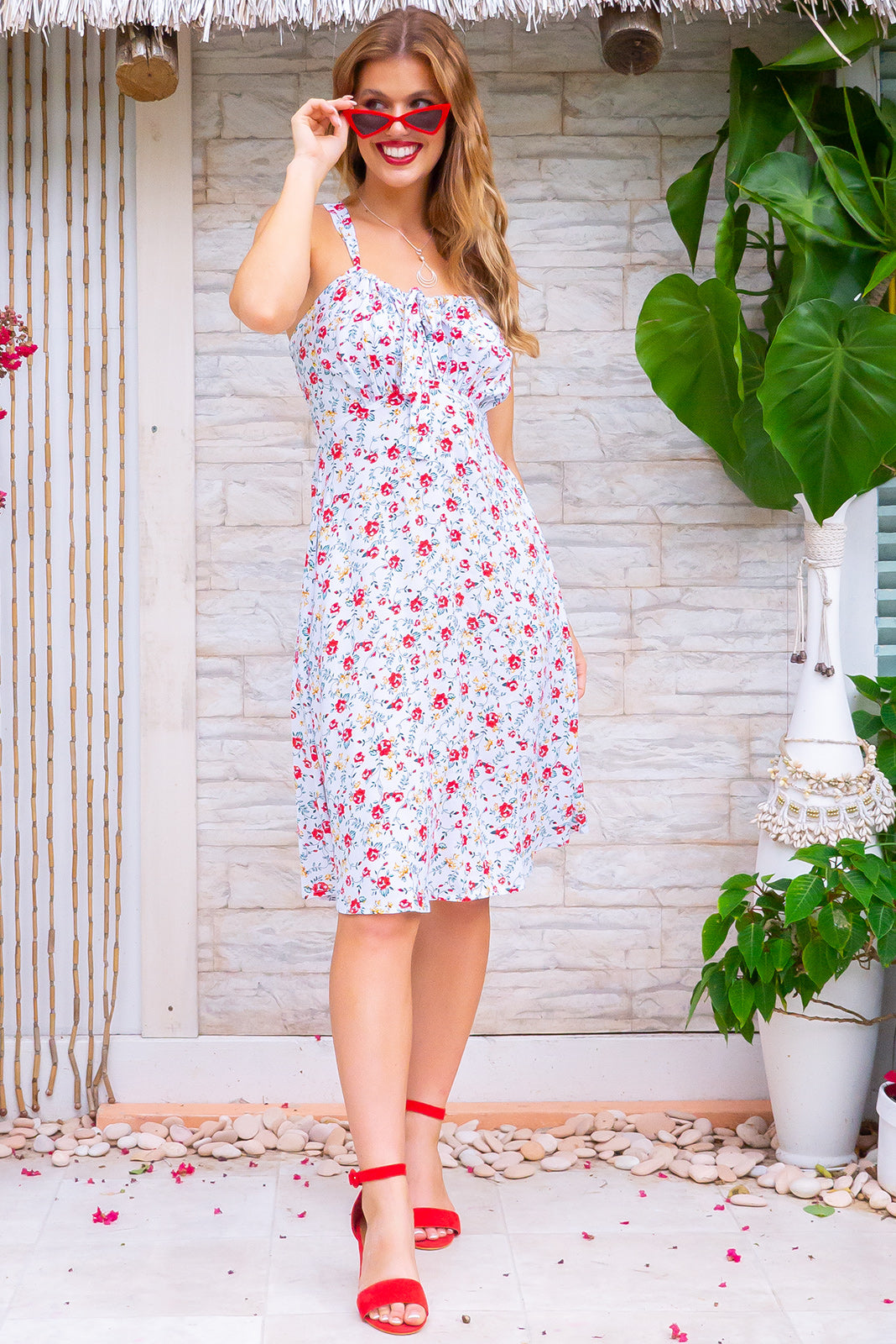 Jay Bay Roses and Stars Mini Dress, bohemian summer style, 100% viscose, elasticated shirred back, sleeveless, keyhole adjustable drawstring design on bust, side pockets, white base with small red, gold and forest green floral print.