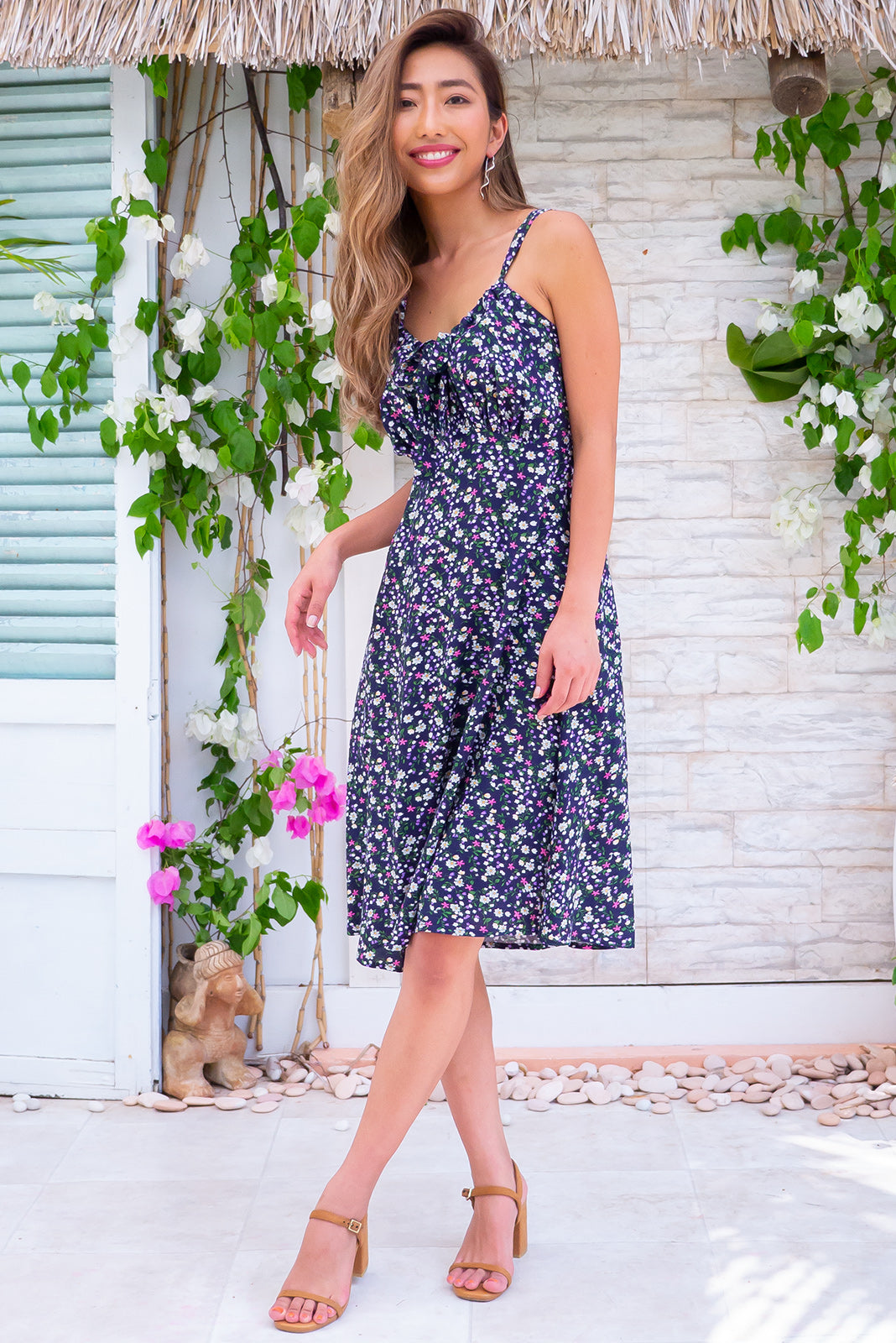 Jay Bay Nikita Navy Mini Dress, bohemian summer style, side pockets, adjustable drawstring design, navy base with small floral print featuring fuchsia, white, gold and forest green.