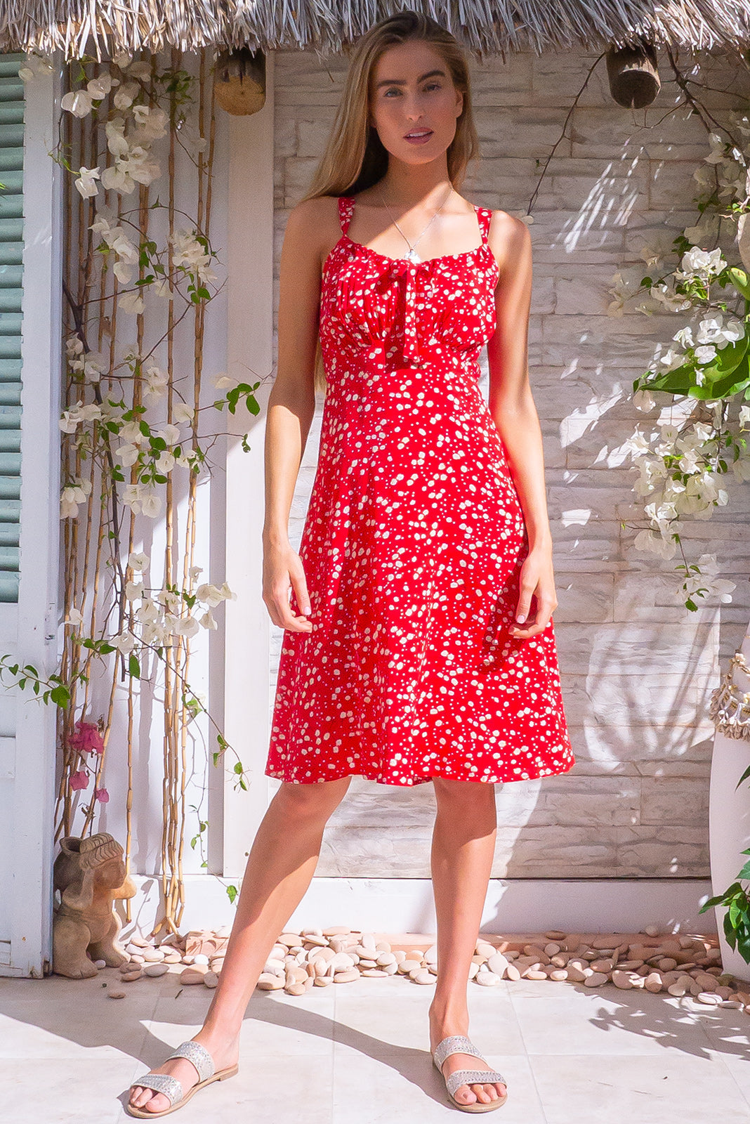 Jay Bay Dandelion Red Dress, bohemian summer style, 100% viscose, elasticated shirred back, sleeveless, adjustable keyhole drawstring design on bust, bright red base with small white dandelion print.