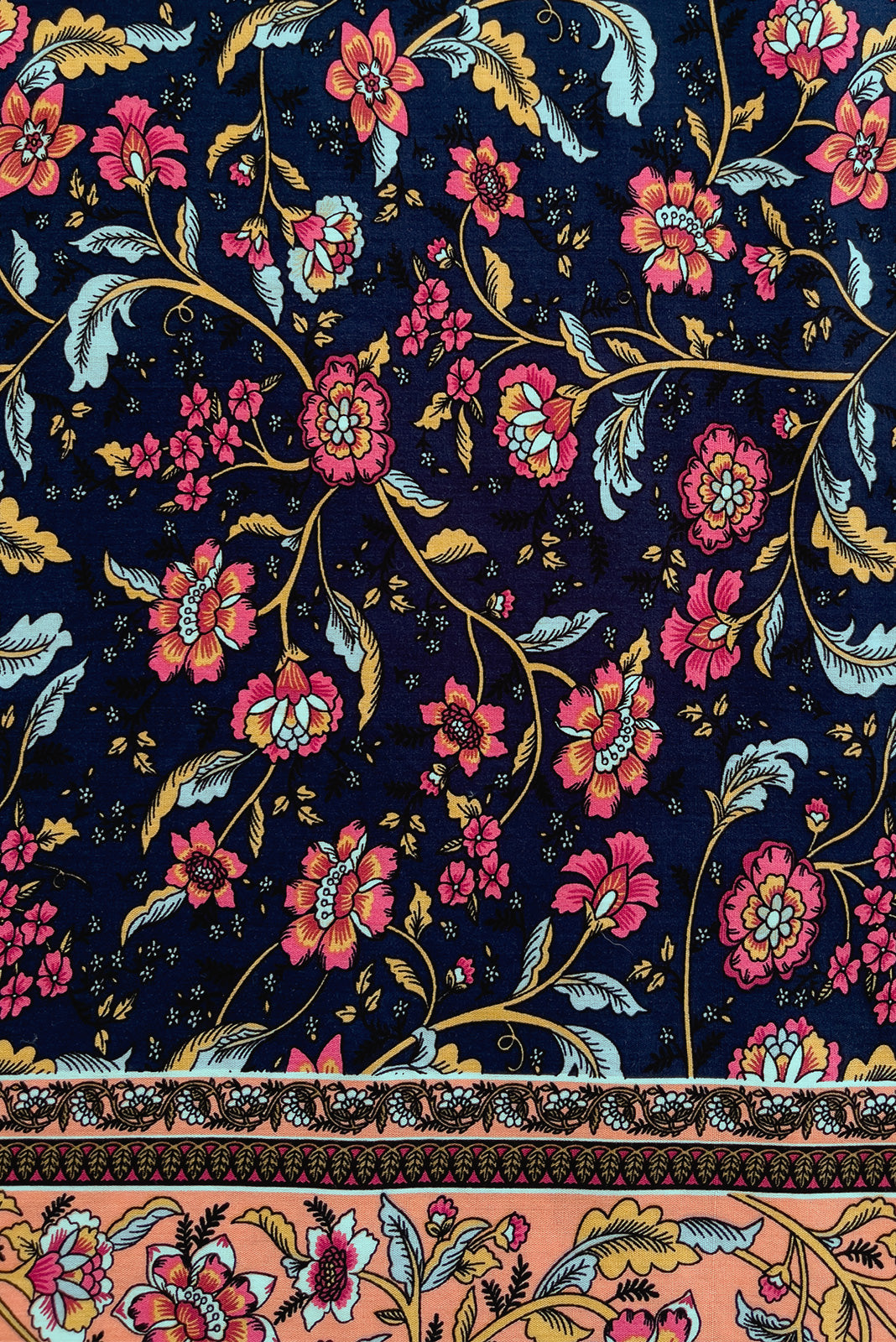Fabric Swatch of Jaye Navy Maxi Dress featuring 100% rayon in navy base with boho floral print and border feature.