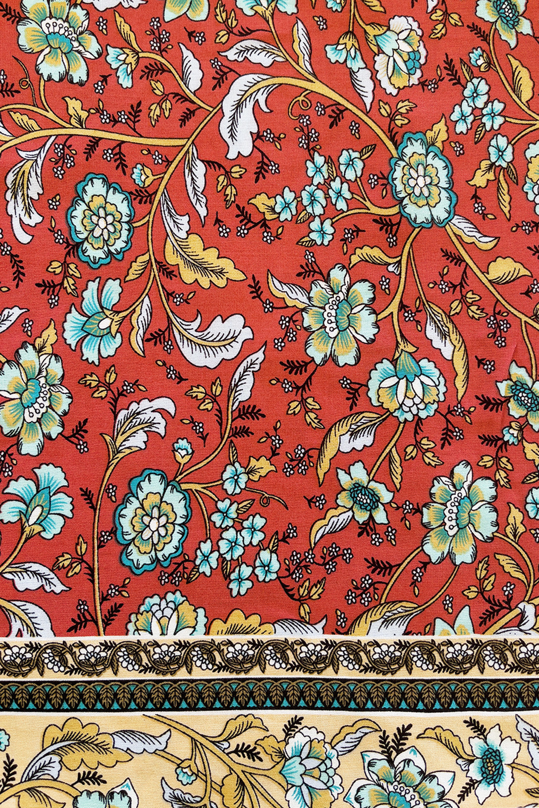 Fabric swatch of  Jaye Rusty Red Maxi Dress featuring woven 100% rayon in  orange red base with boho floral print and border feature.