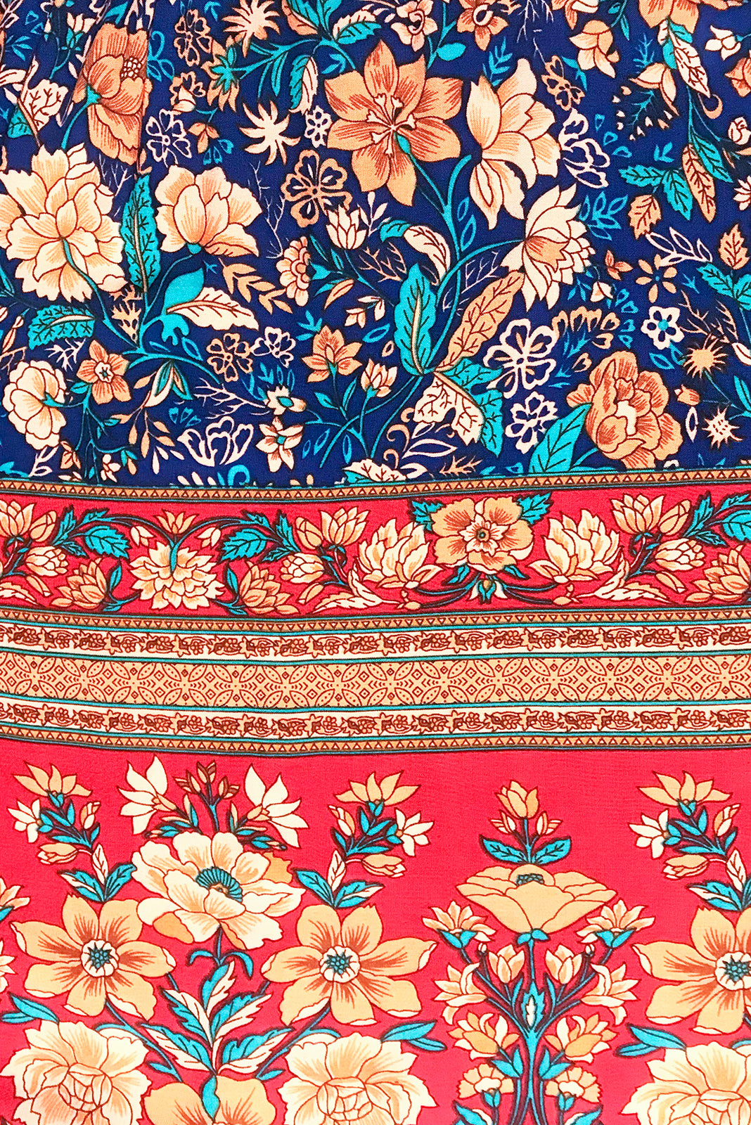 Fabric Swatch of Jennifer Jos Blue Dress is a rust navy and ruby red bohemian border print on a 100% woven rayon.
