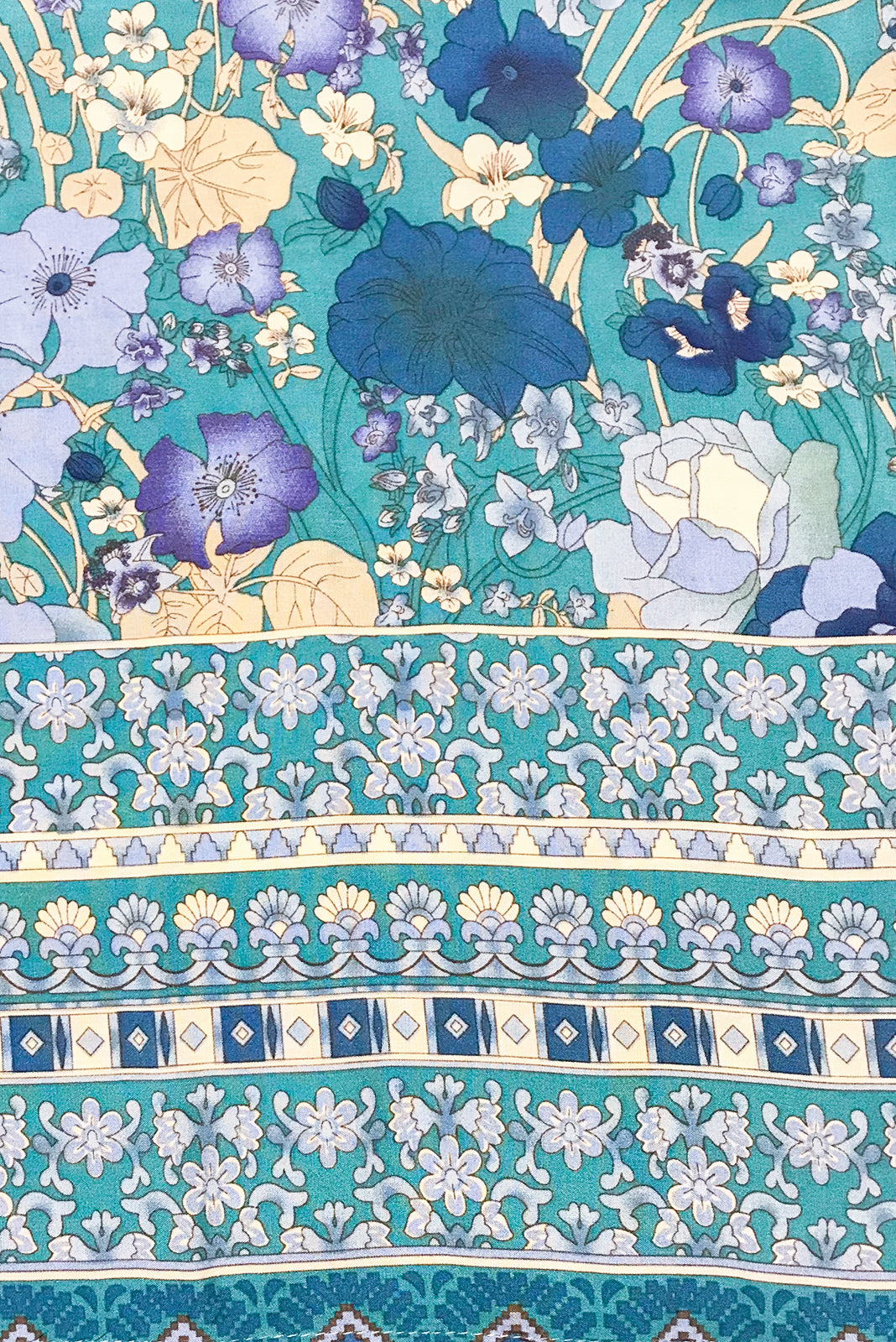 Fabric Swatch of Jennifer Verte Fleur Dress features rayon in Green base with stunning blue art deco floral print, border print at hem.