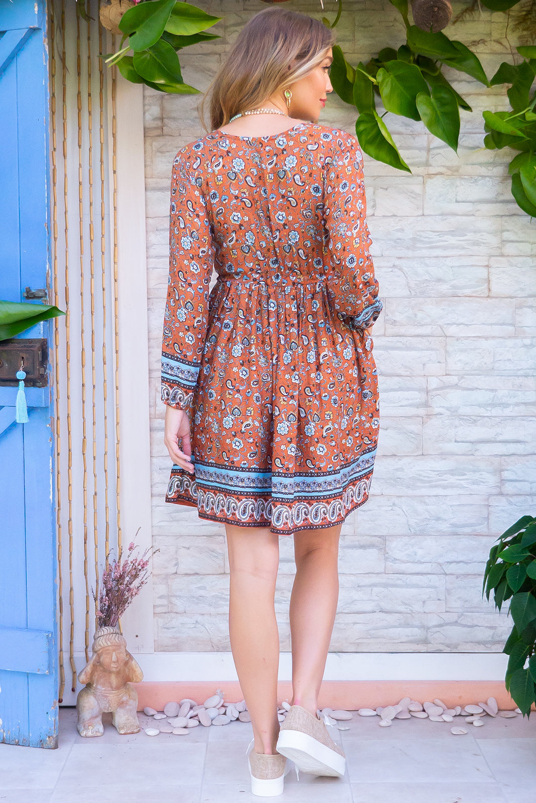 Jennifer Jaffa Ginger Dress with a button front, long sleeve with elastic at the wrist, side pockets and a full skirt in a soft rusty and turquoise bohemian border print on a 100% woven rayon chic and effortless style