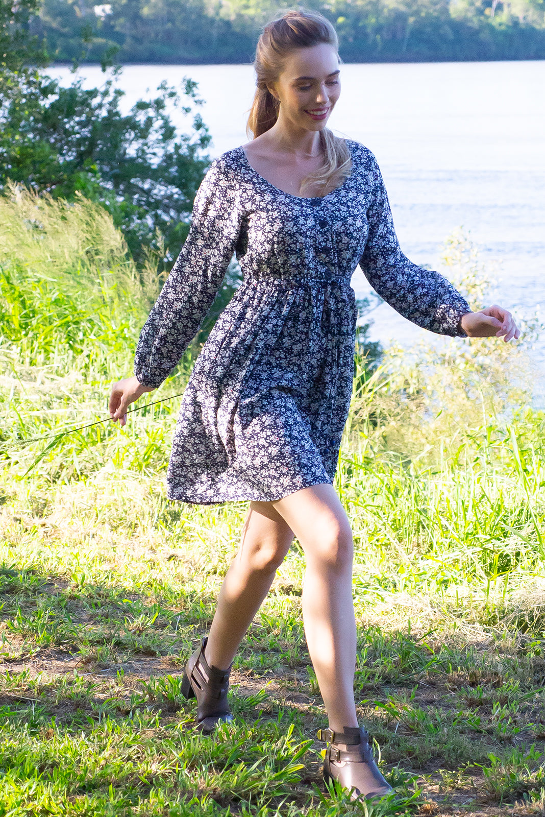 Jennifer Juno Navy Dress with a button front, long sleeve with elastic at the wrist, side pockets and a full skirt in a rust navy and white floral ditzy print on a 100% woven rayon chic and effortless style