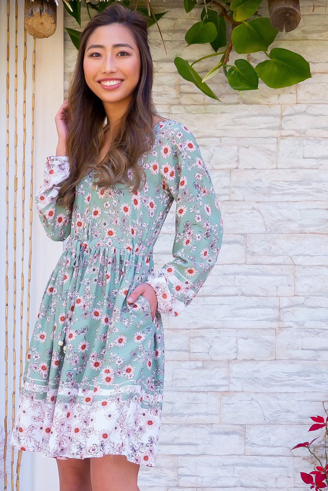 Jennifer Pistachio Green dress is is a bohemian style Spring inspired mini dress. A pastel green with floral pattern. Very sweet and feminine. Long sleeves and drawstring. 100% rayon.