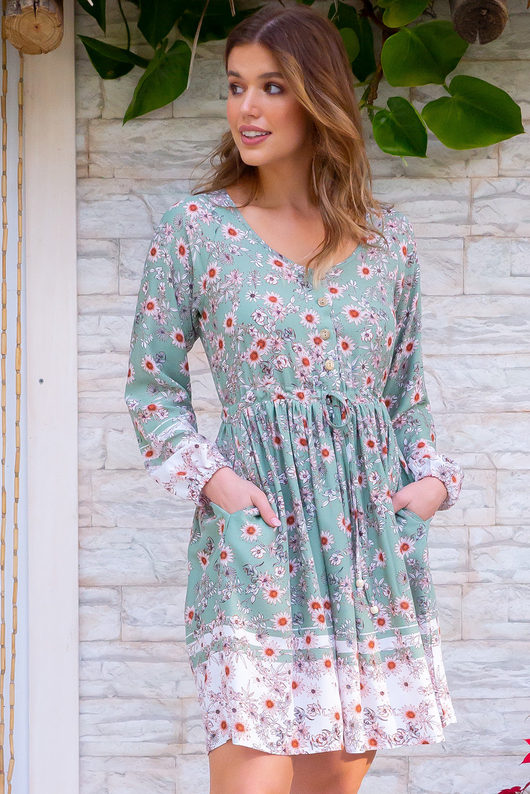 Jennifer Pistachio Green dress is a bohemian style Spring inspired mini dress. A pastel green with floral pattern. Very sweet and feminine. Long sleeves and drawstring. 100% rayon.