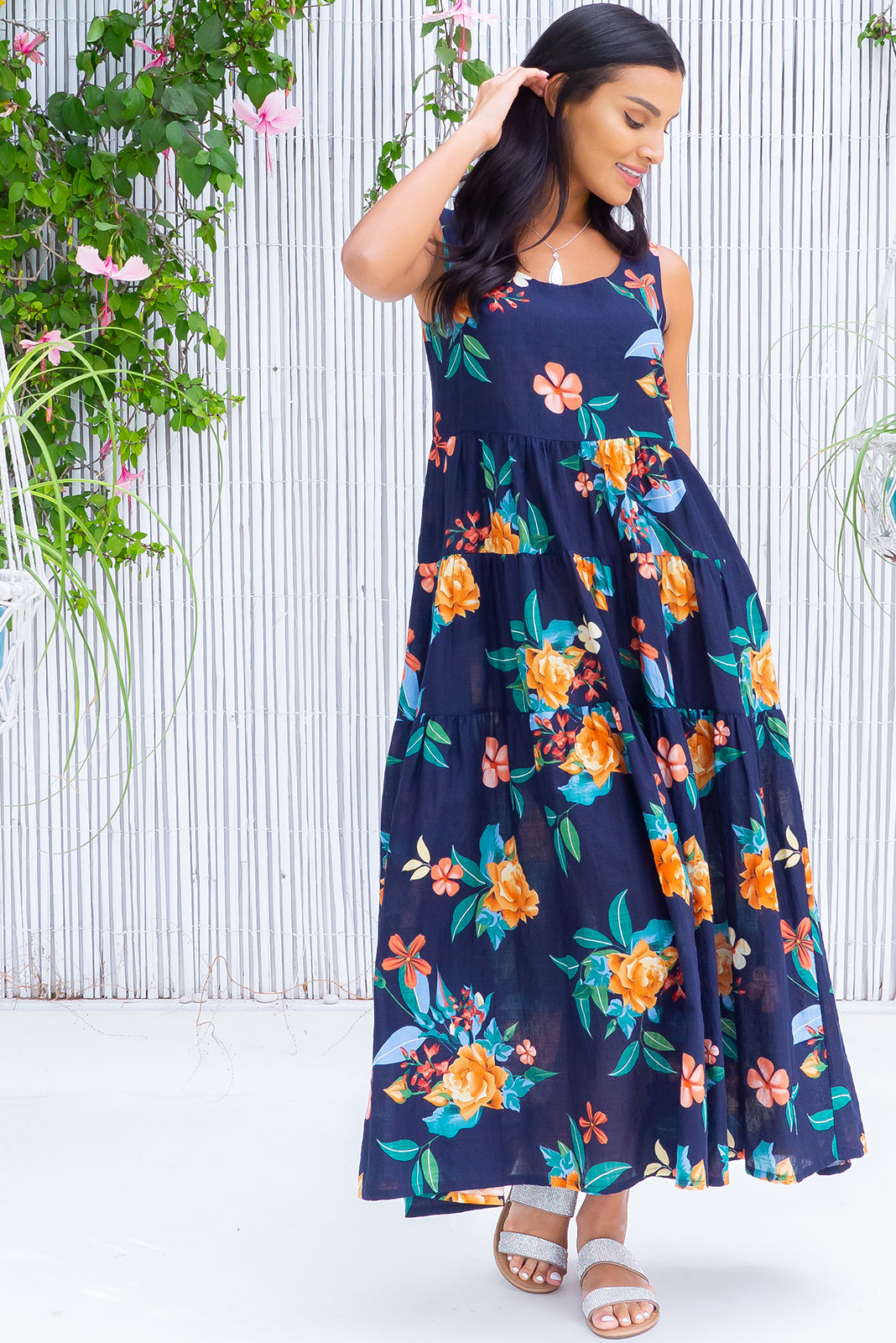 The Jina Ink Maxi Dres features lightweight/non-stretch fabric, scooped neckline, lined bust, side pockets, tiered, full skirt and 70% cotton, 30% rayon in ink base with large tropical floral print.