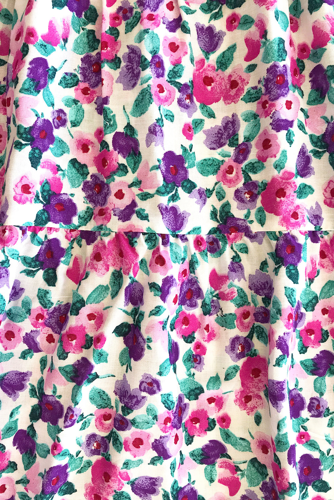 Fabric Swatch of Jina Magenta Dress featuring 100% rayon in white base with pink and purple floral print.